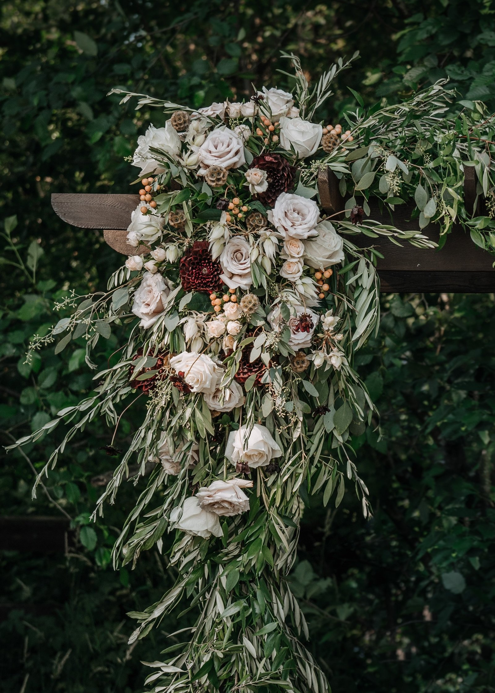 Olive branch blush wedding flower ceremony arch