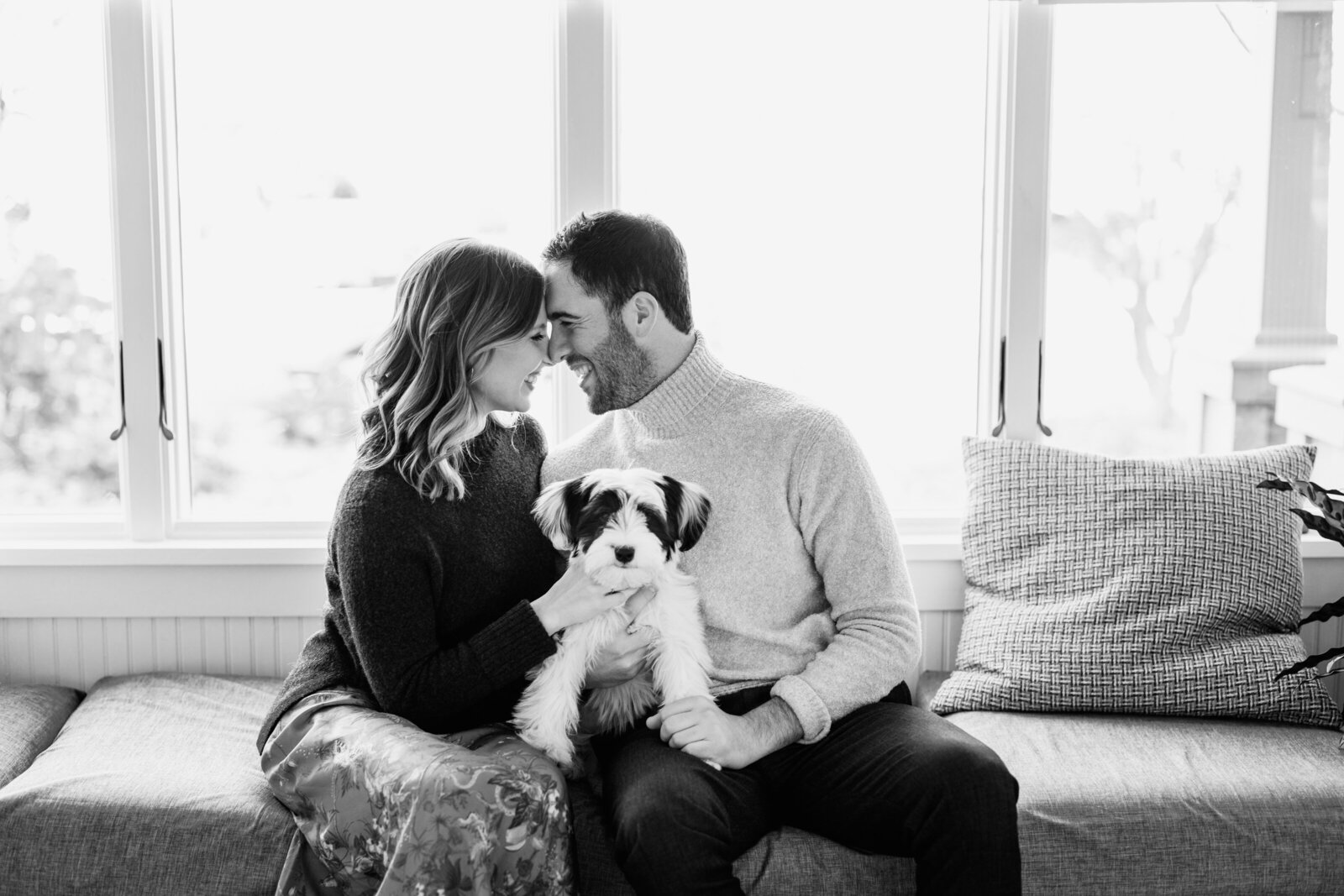 couple at modern home with dog