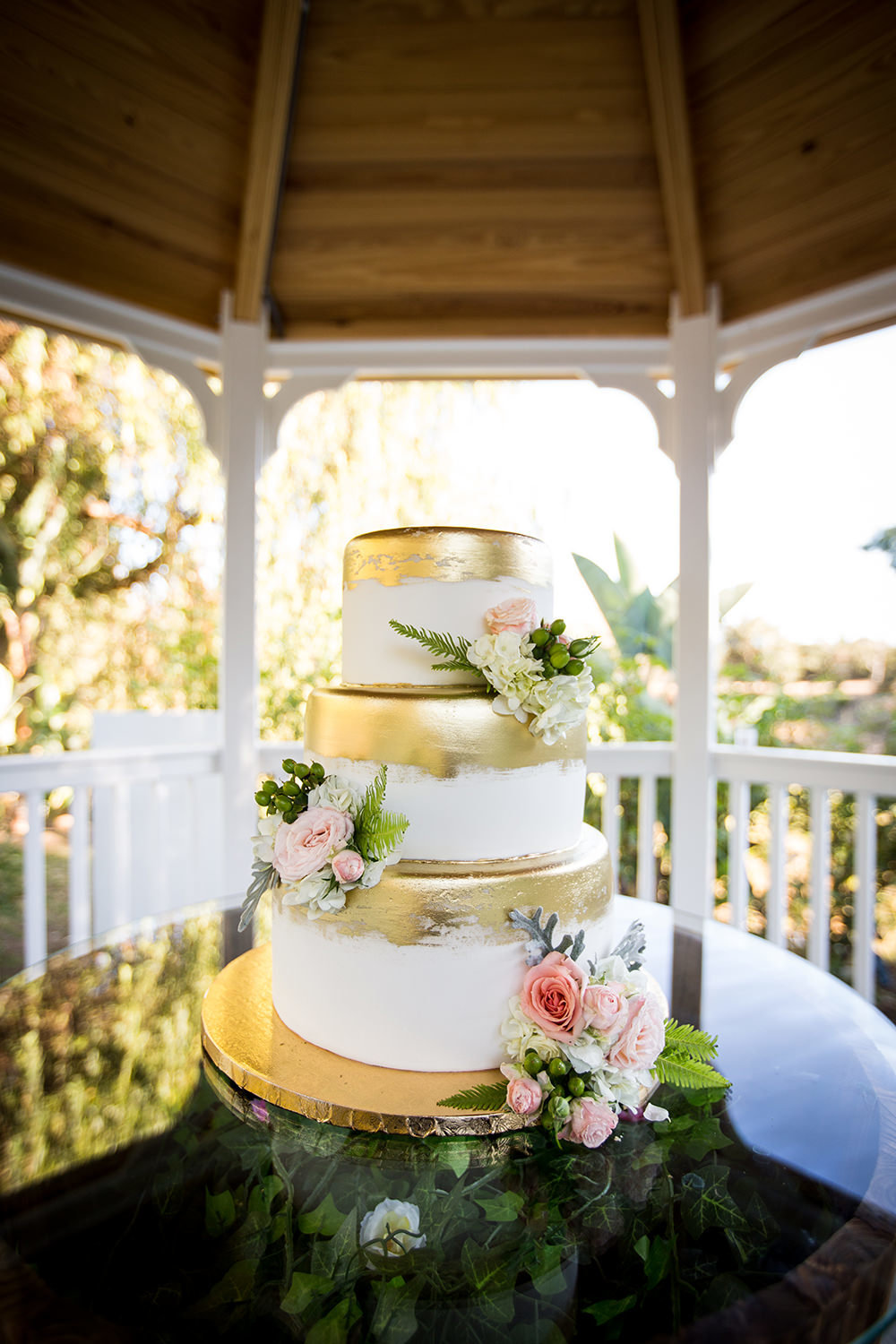 wedding cake with gold and pink