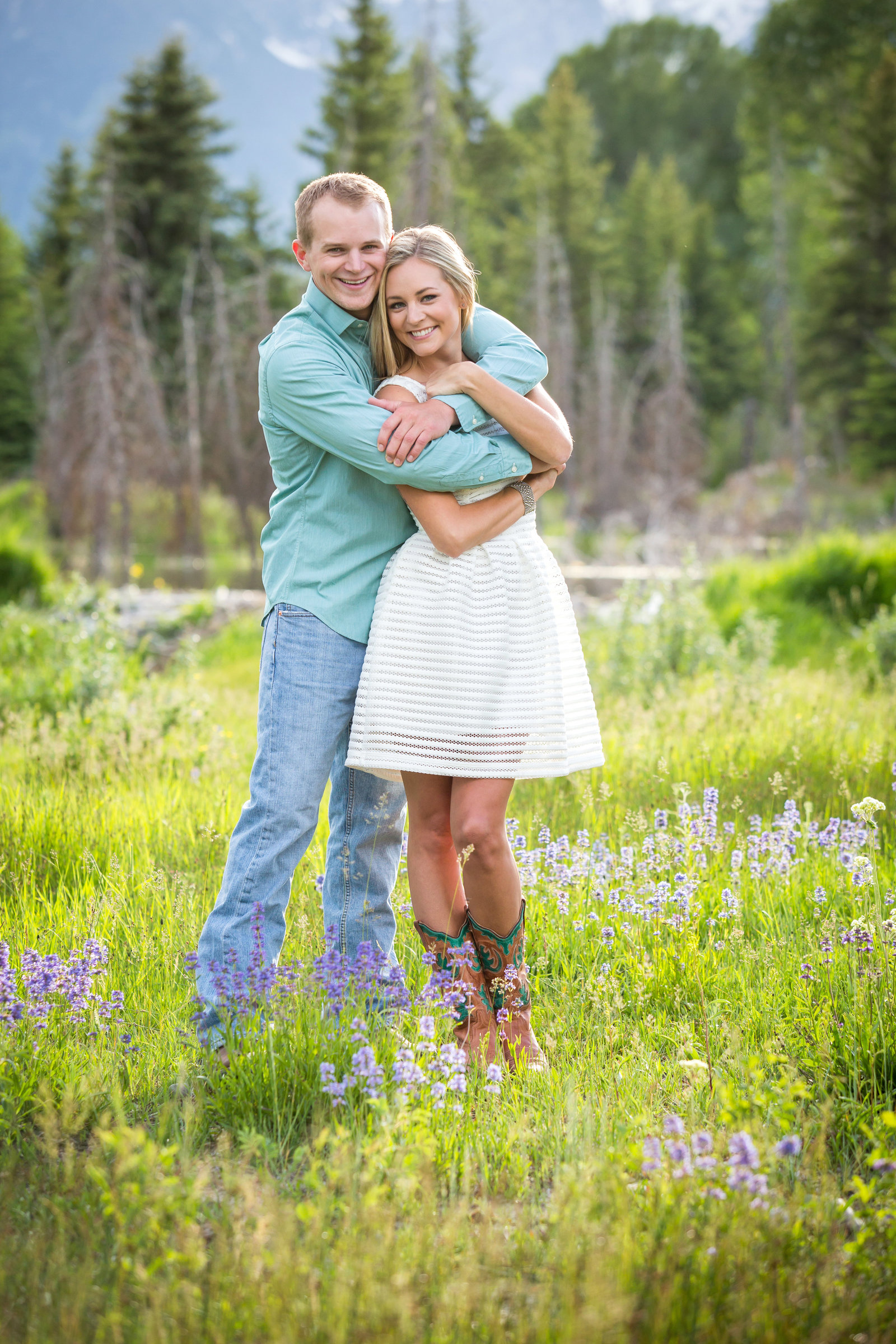 Engagement session in flowers at Schwabacher's landing