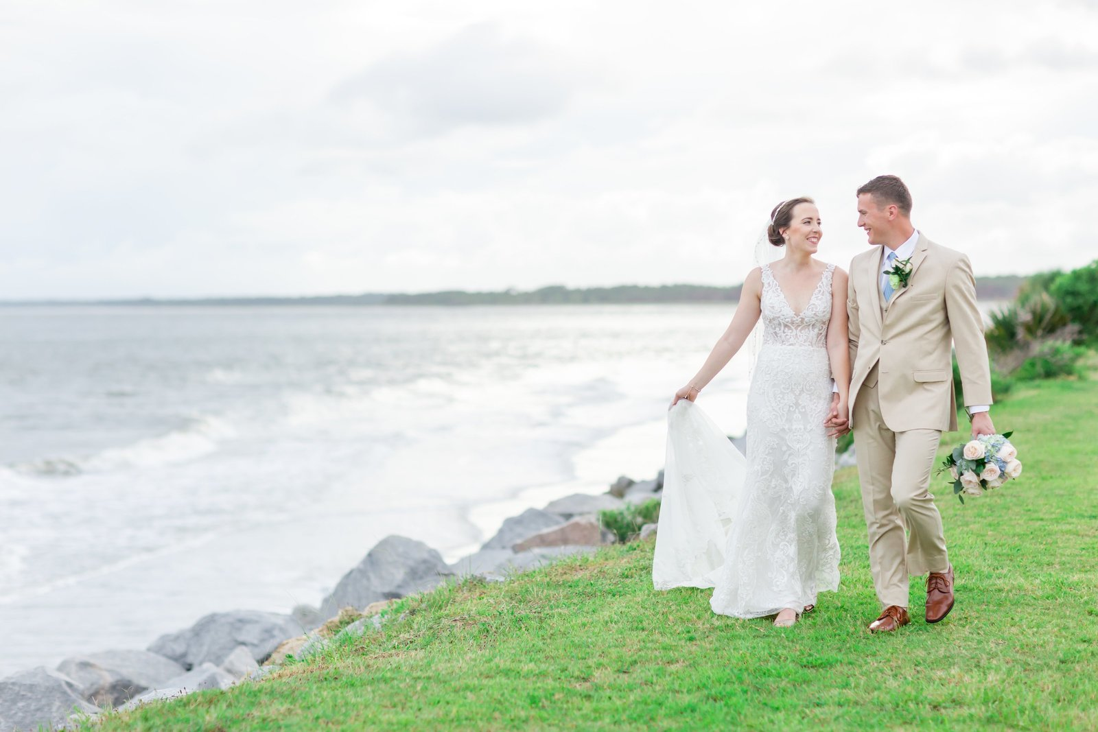 bride and groom walk together at the seabrook island club wedding venue photographed by charleston wedding photographer