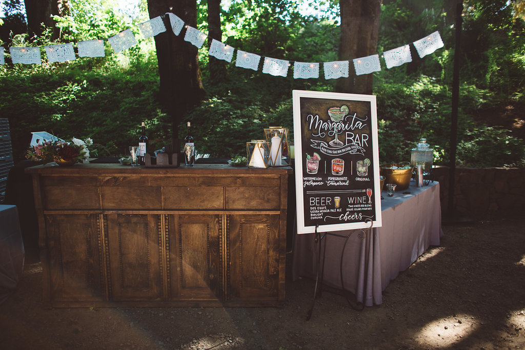 Margarita bar set up at an outdoor wedding at horinings hideout in Oregon