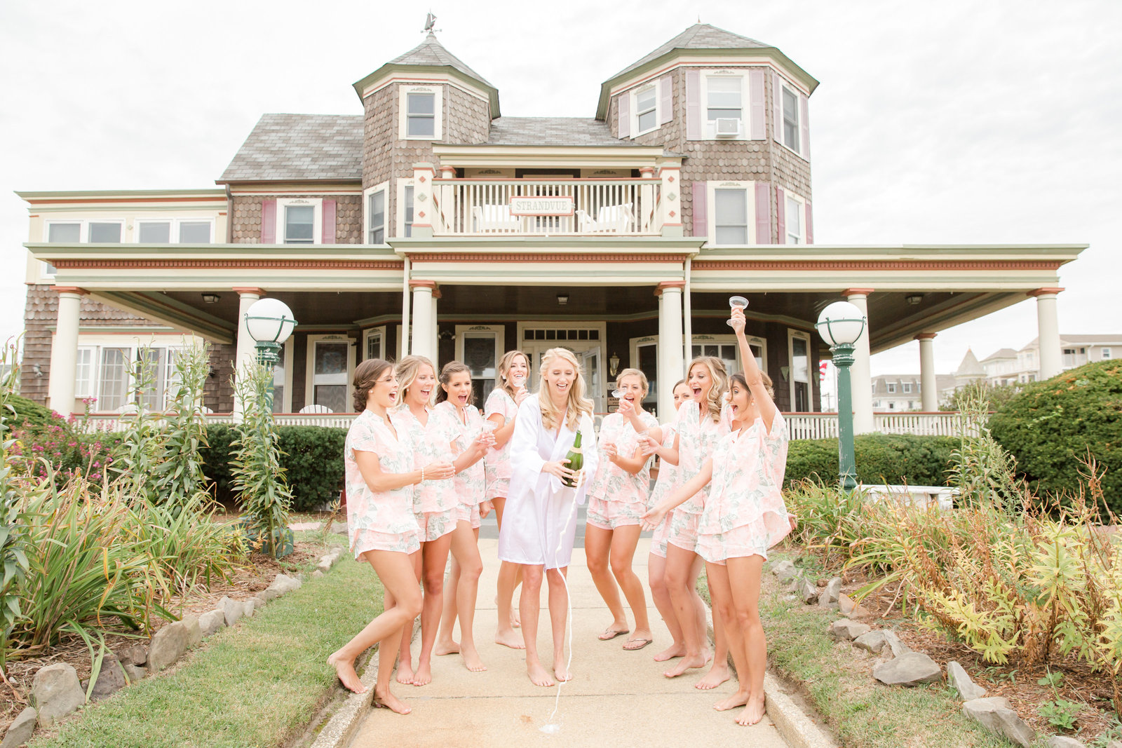 Bridesmaids drinking champagne on wedding morning