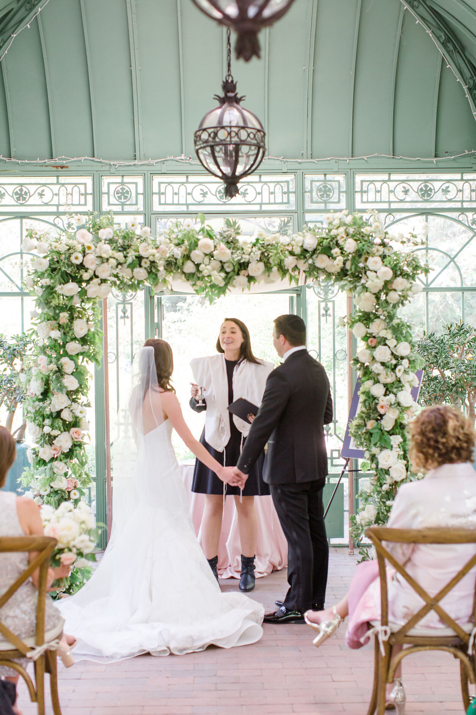 white and blush flowers on chuppah, michele with one l, jewish wedding, denver botanic gardens wedding, woodland mosaic ceremony, microwedding flowers