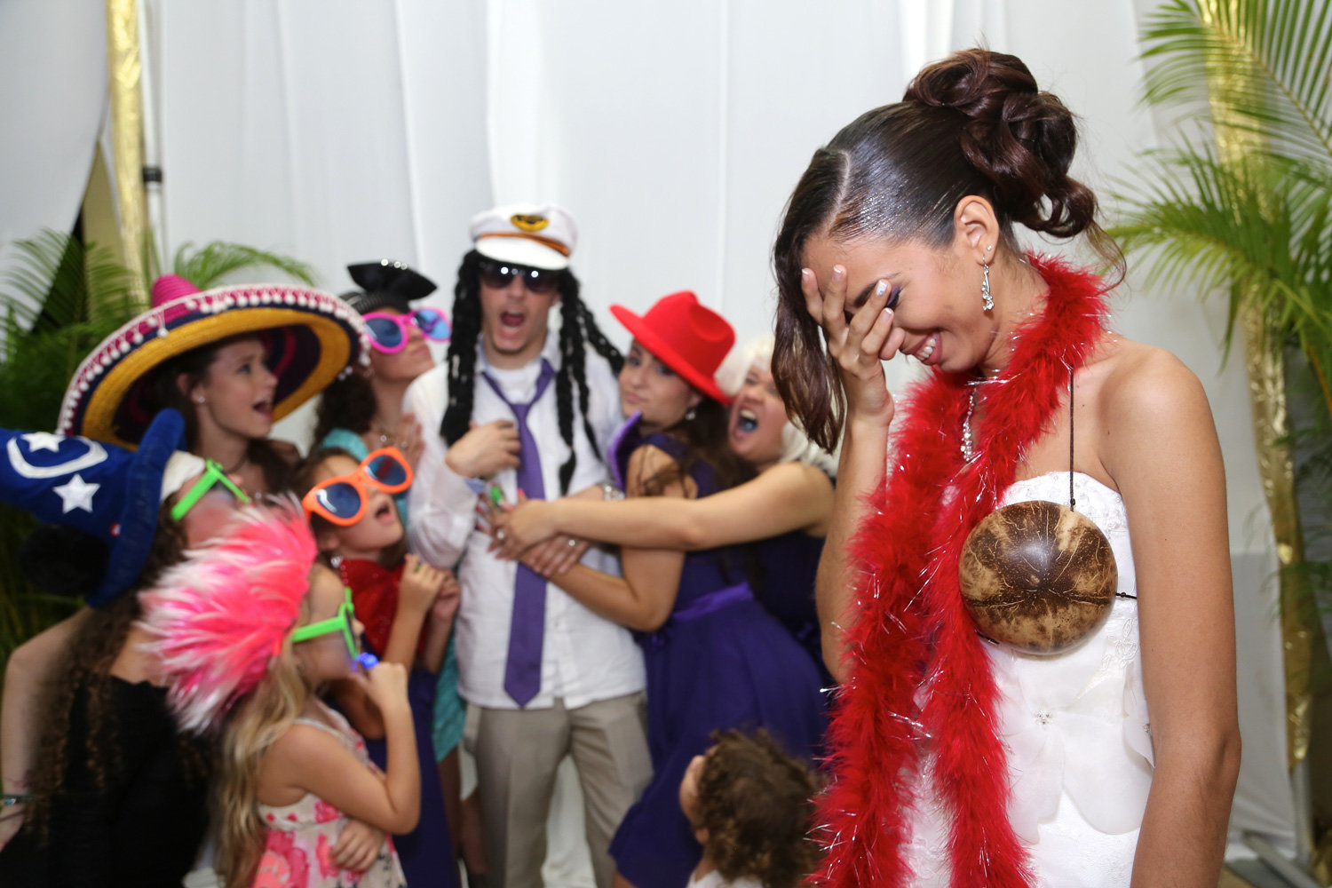 Family having fun in wedding photobooth. Photo by Ross Photography, Trinidad, W.I..