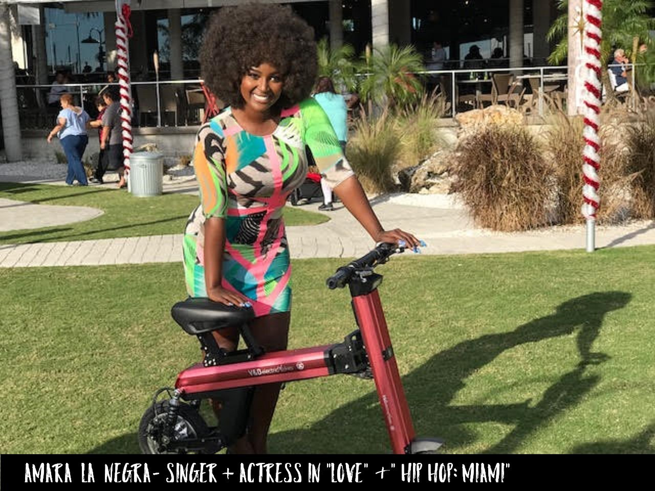 Actress and singer from Love & Hip Hop Amara La Negra is promoting the Red Go-Bike M2