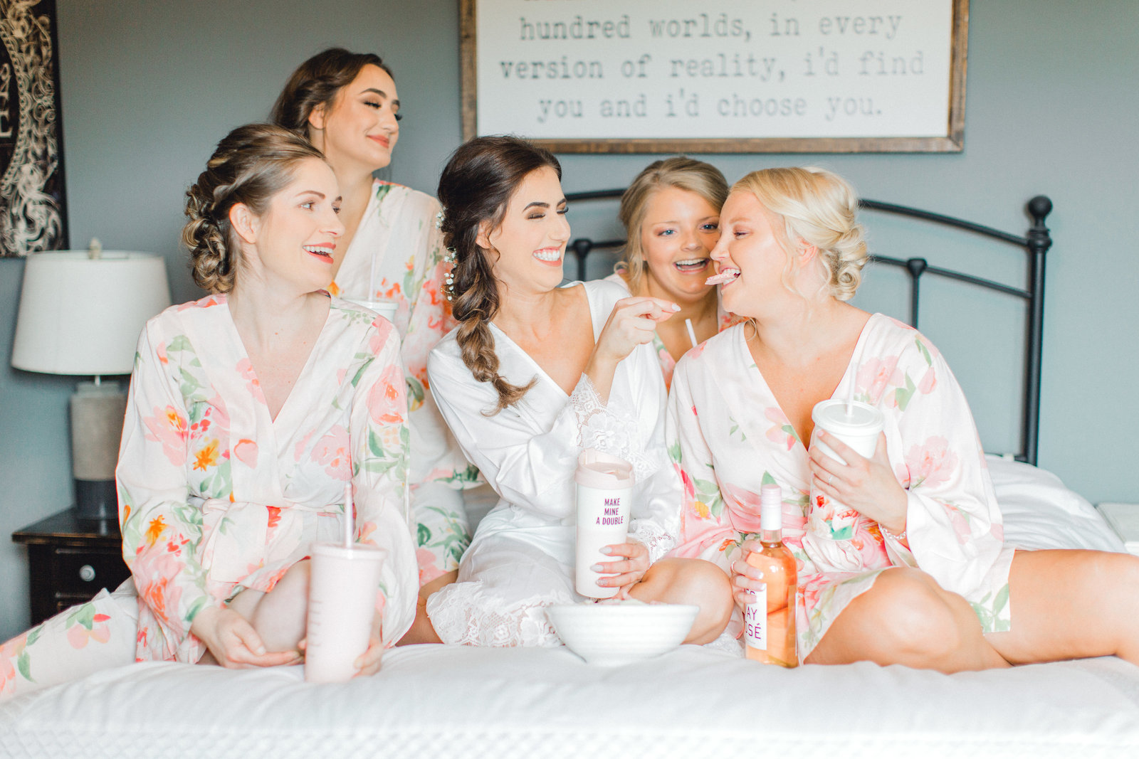 getting ready with bridesmaids in matching bridesmaids robe for an iowa wedding
