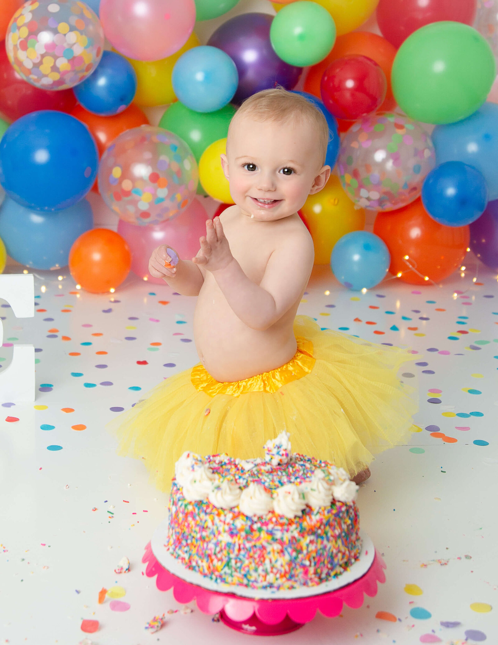 Precious one year old girl at her cake smash in Rochester, NY.