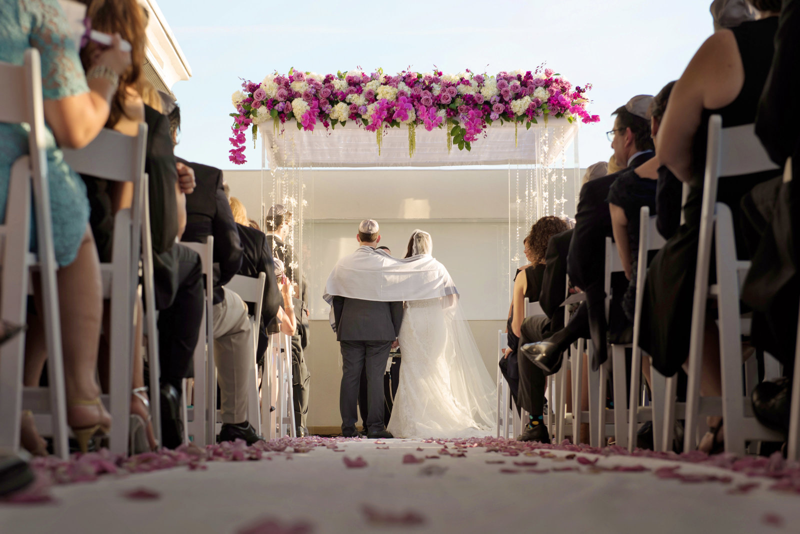 Bride and Groom under the Chuppah during a jewish wedding