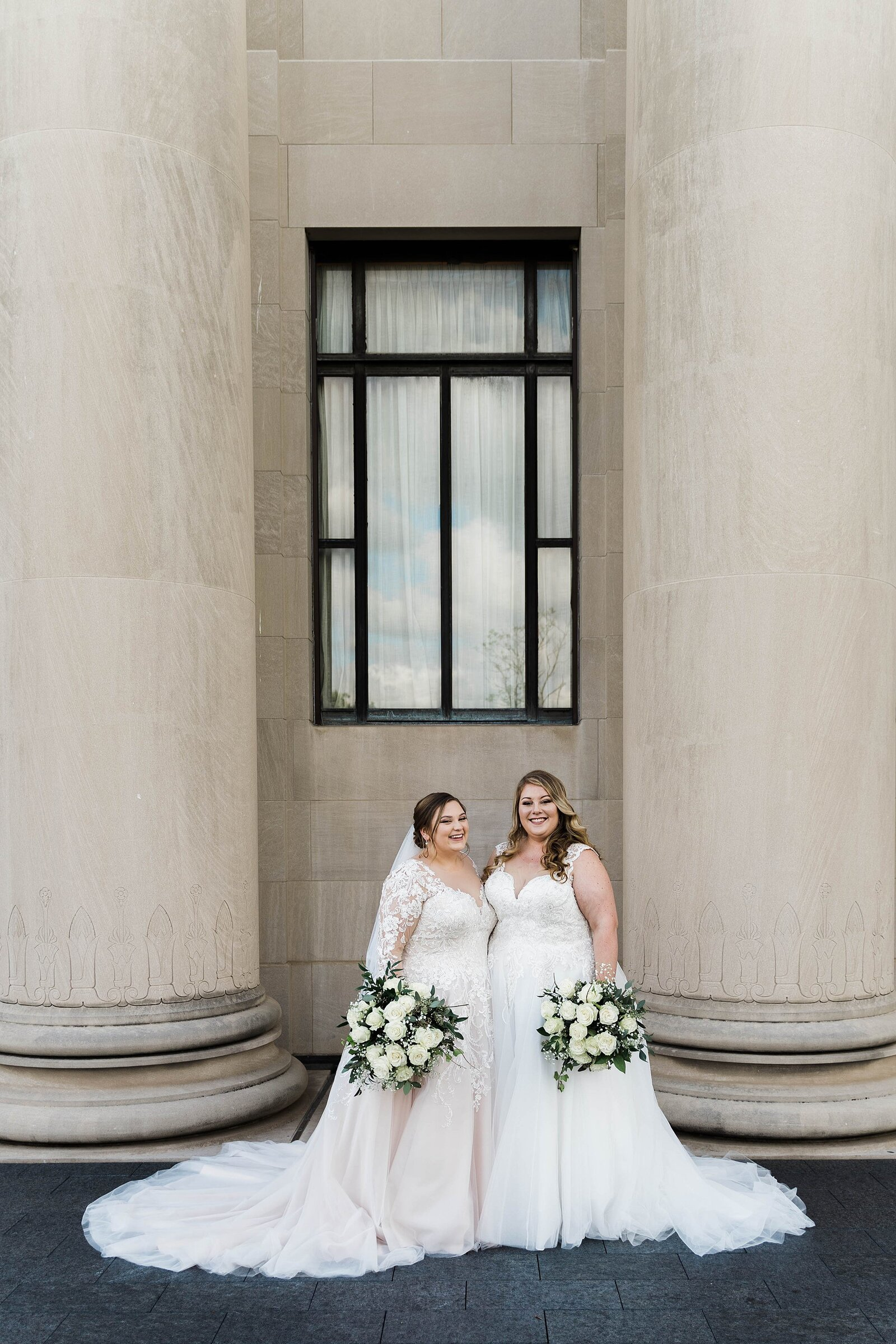 LGBTQ brides pose in front of Nelson Atkins Museum
