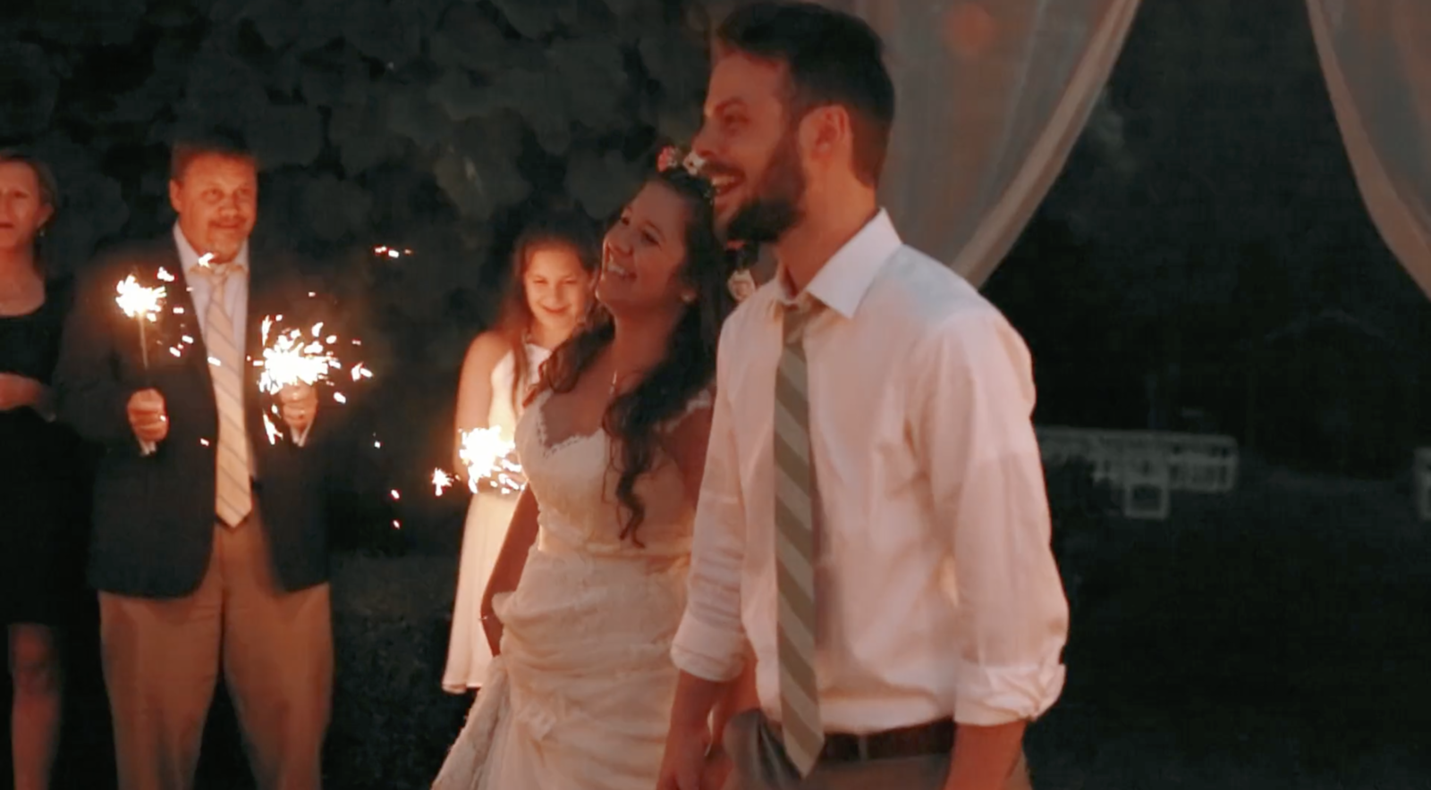 bride and groom exit reception with sparklers at jardin del sol