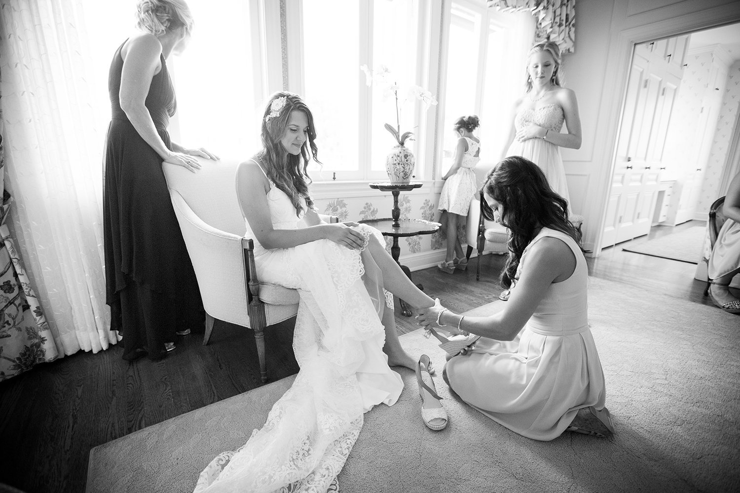 bride with lace dress at darlington house getting shoes on