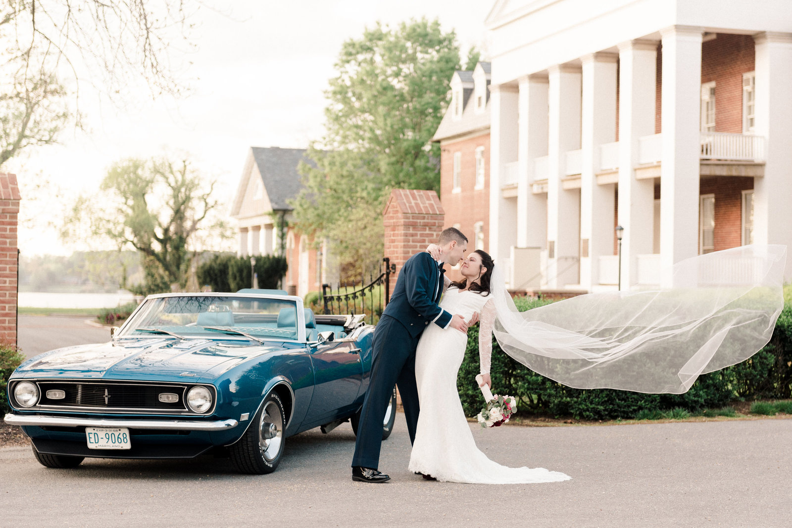 Maryland bride and groom in front of vintage car