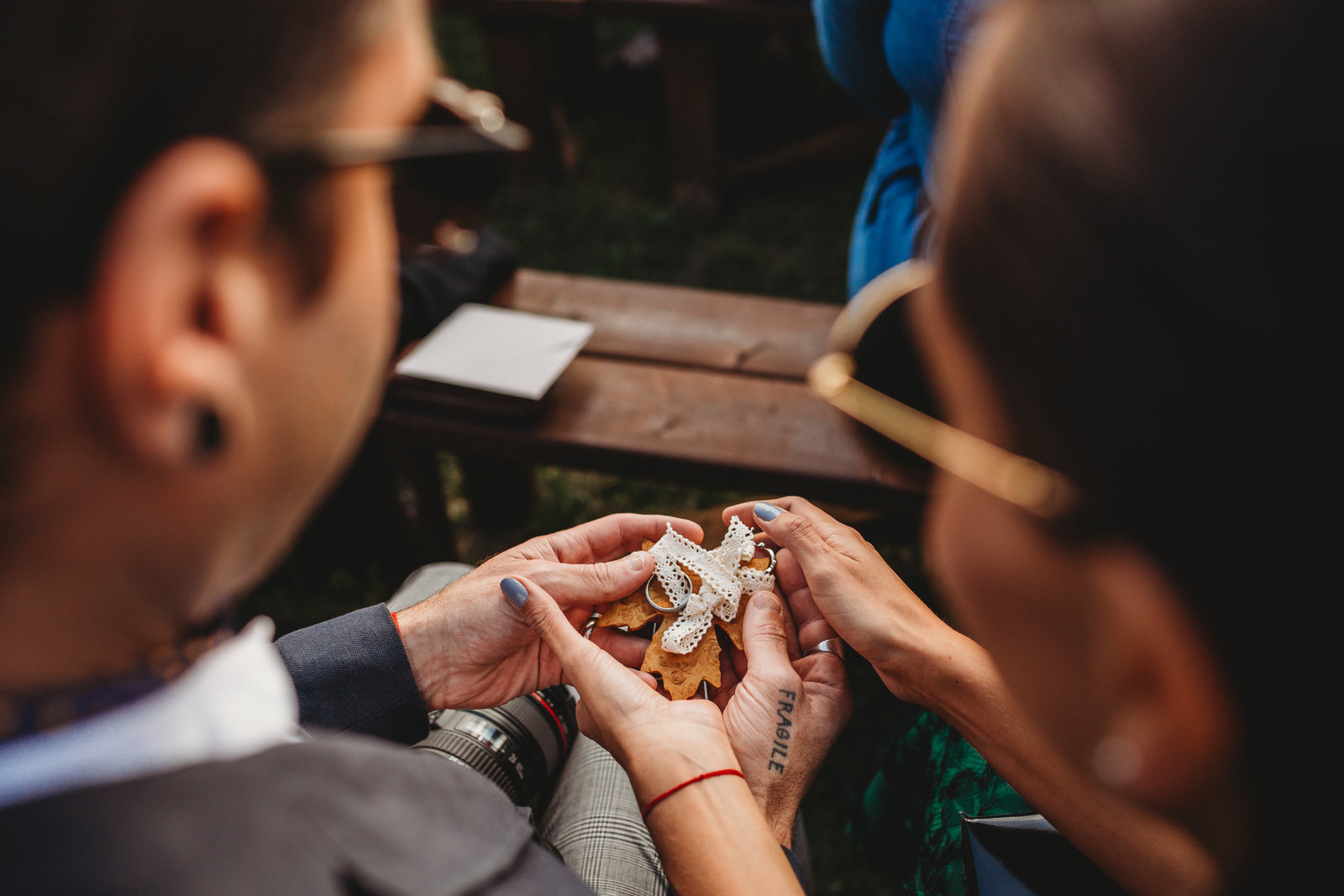 guests pass keepsakes during wedding ceremony in mass