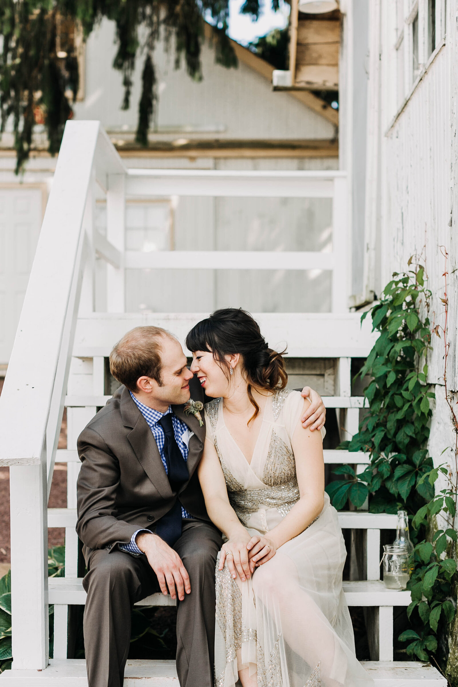 couple in vintage dress on farm steps