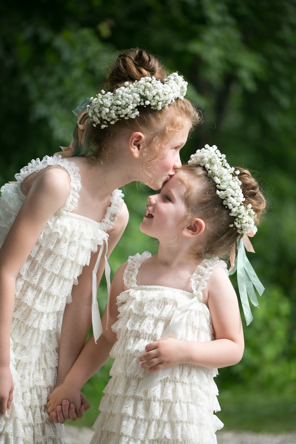 Sweet flower girls with babies breath floral crowns, in J.Crew dresses at rustic wedding in Maine