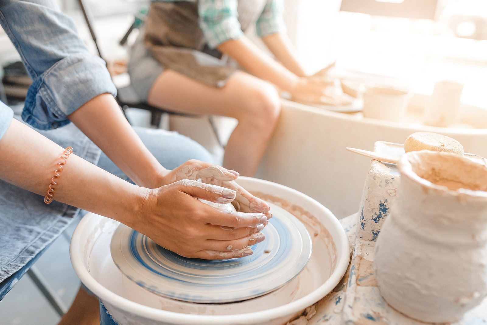 Girls working with Pottery