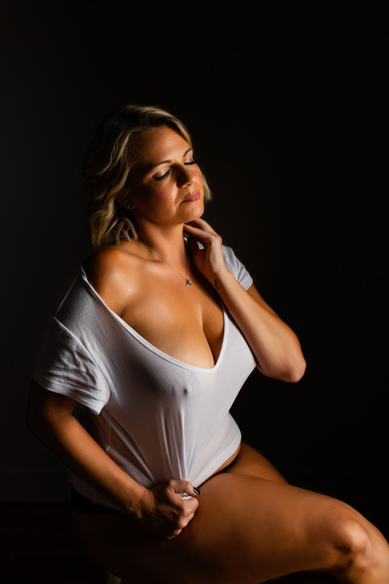 Fine art boudoir photo of a woman wearing a wet t-shirt