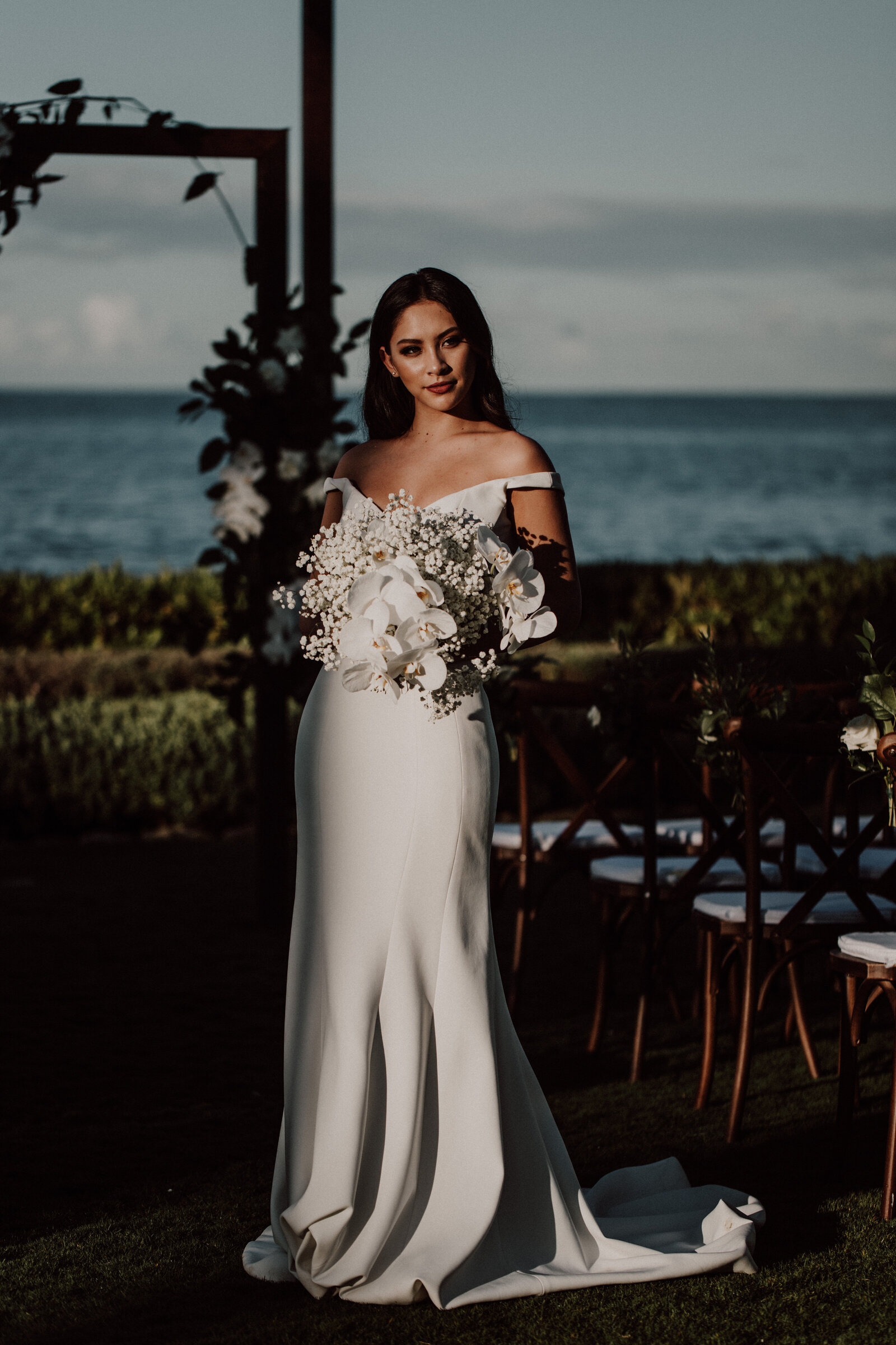 bride-standing-in-front-of-ocean-lawn-wearing-ines-de-santo