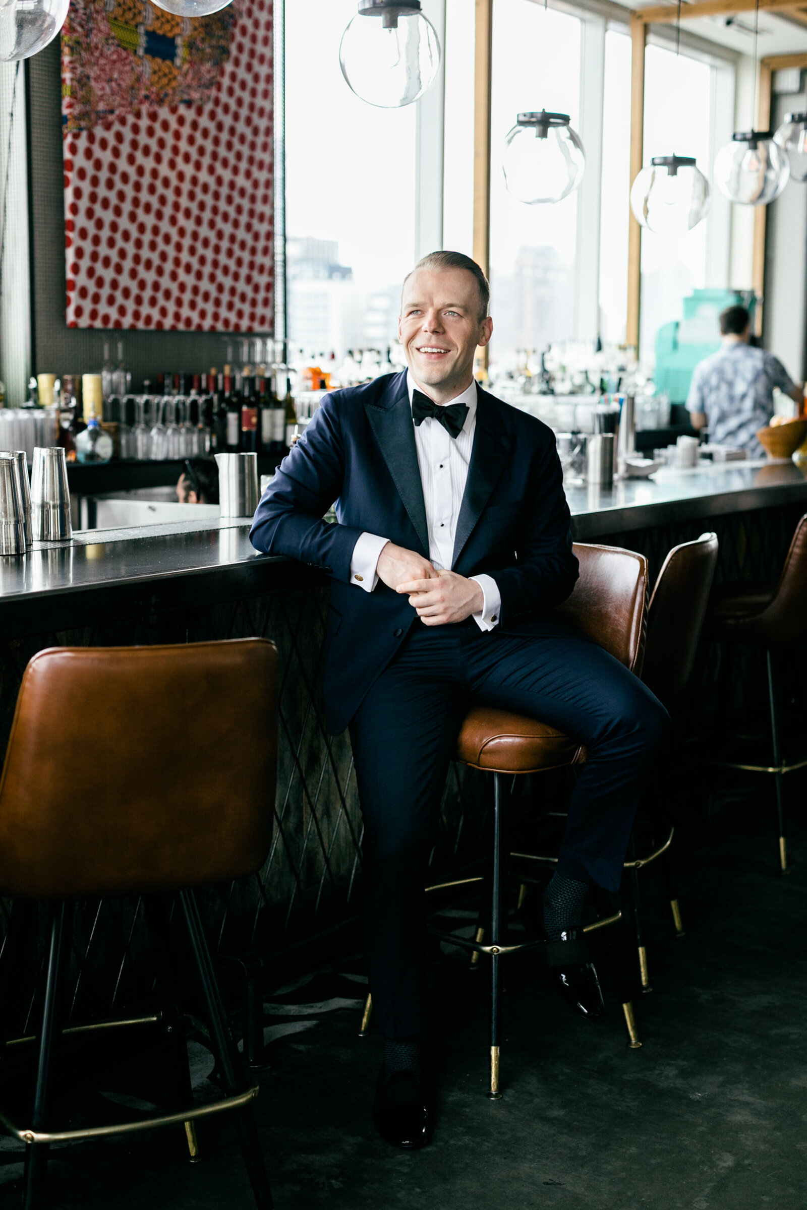 groom in tux at restaurant bar
