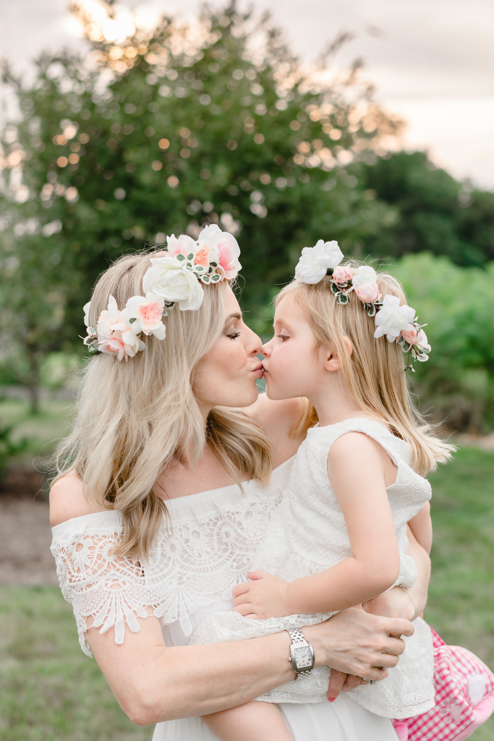 mom and daughter wearing matching flower crowns