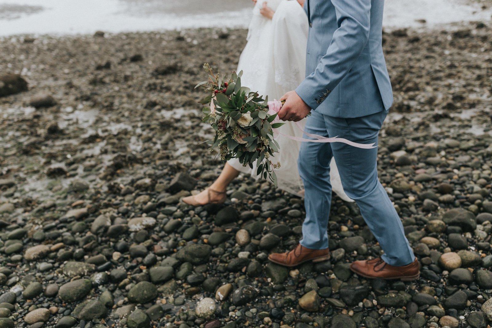 Bride and groom walking on beach in Blaine, WA