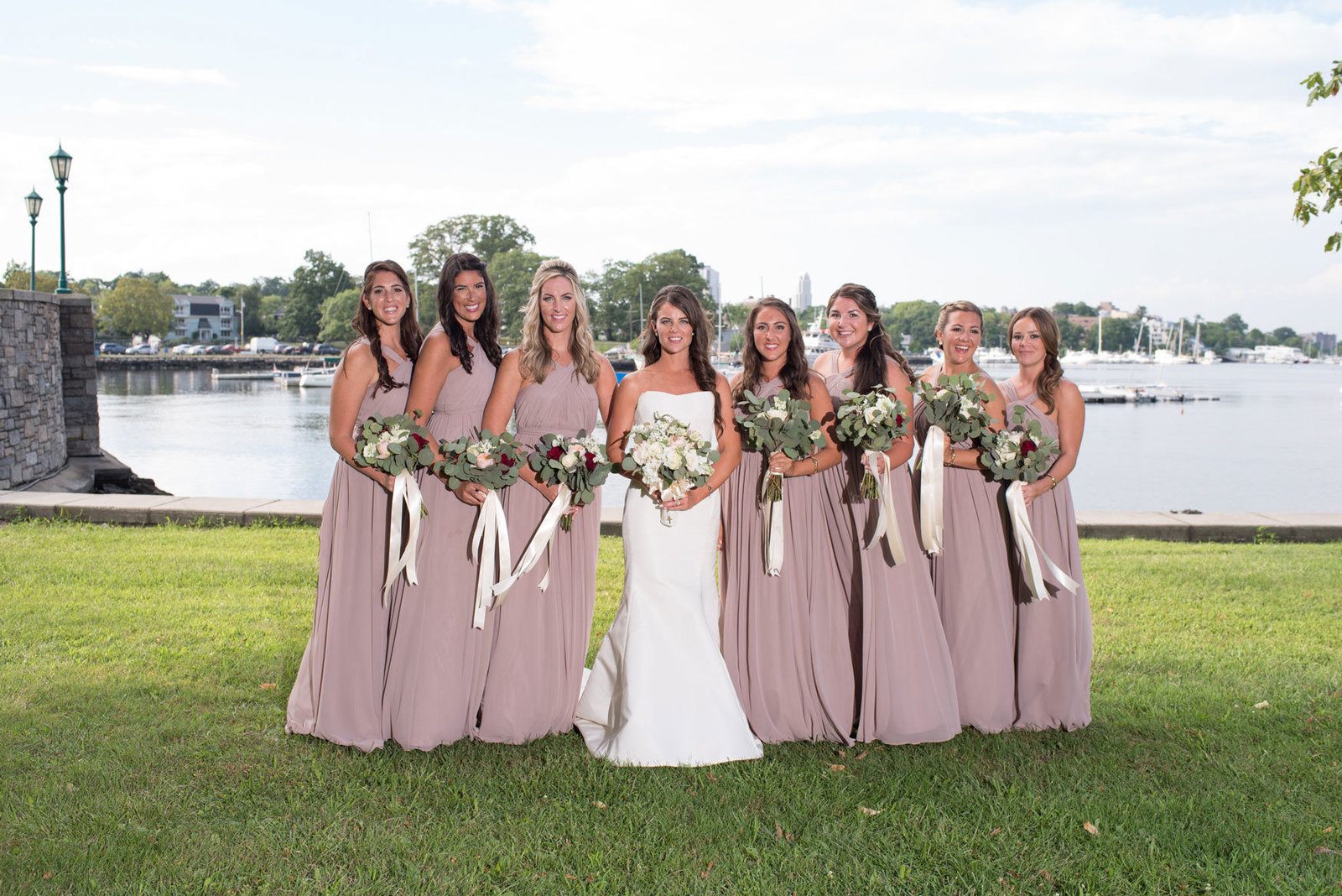 bride and her bridesmaids outside Glen Island Harbor Club