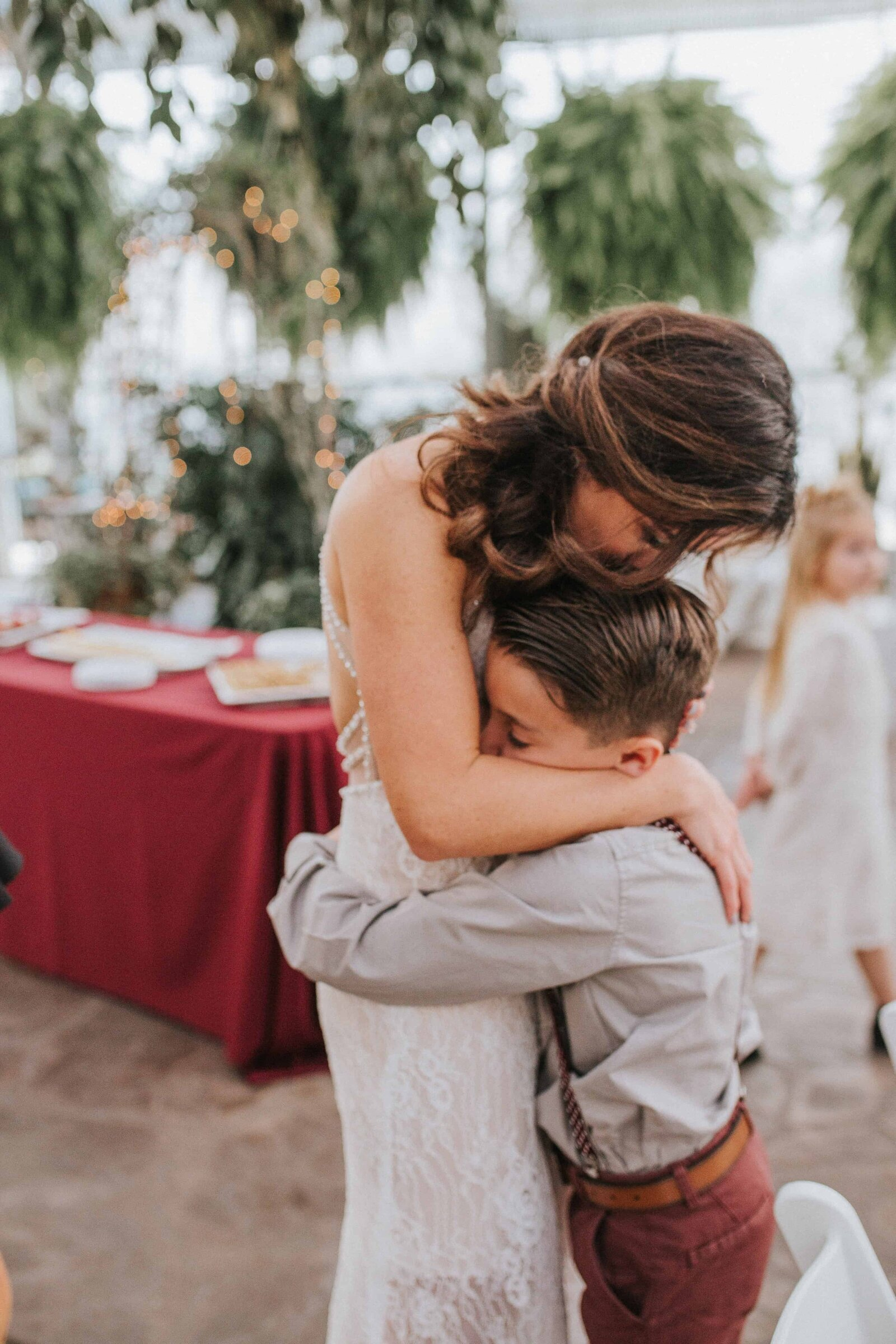 bride hugging little boy in Chattanooga Tennessee