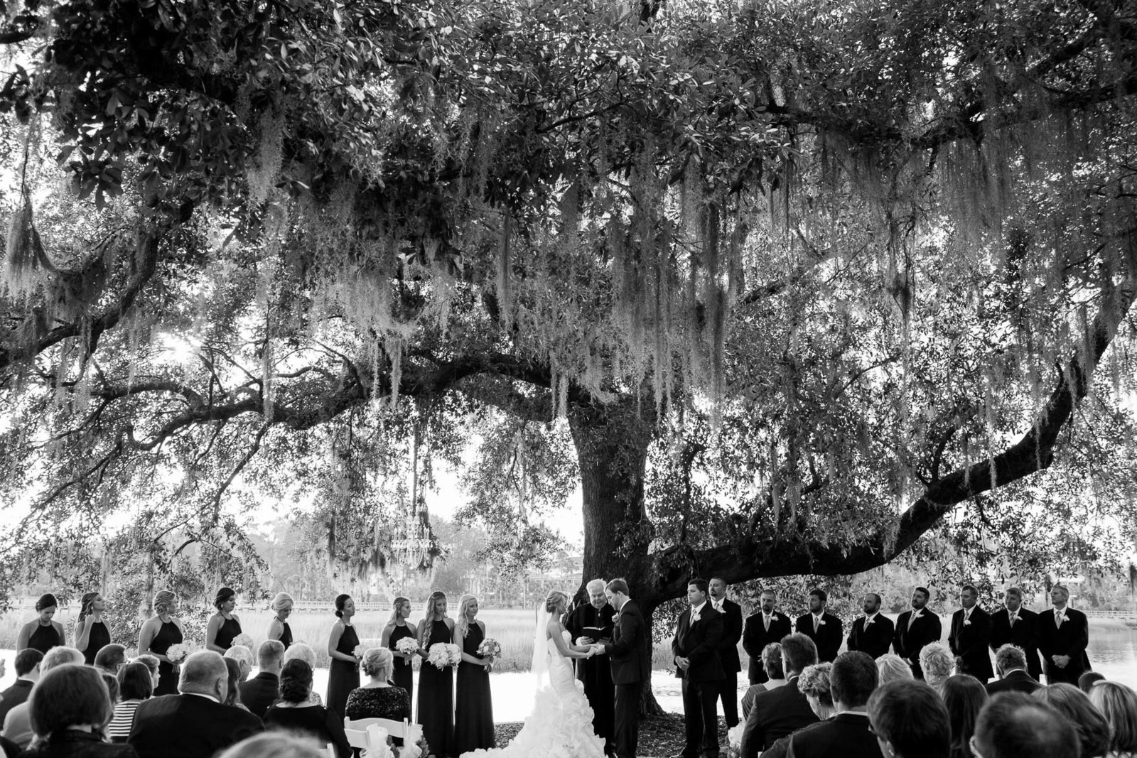 Bride and groom exchange vows under an oak tree, Dunes West Golf and River Club, Mt Pleasant, South Carolina