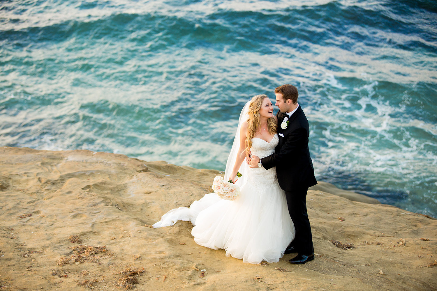 Couple Hugging in La Jolla During La Valencia Wedding