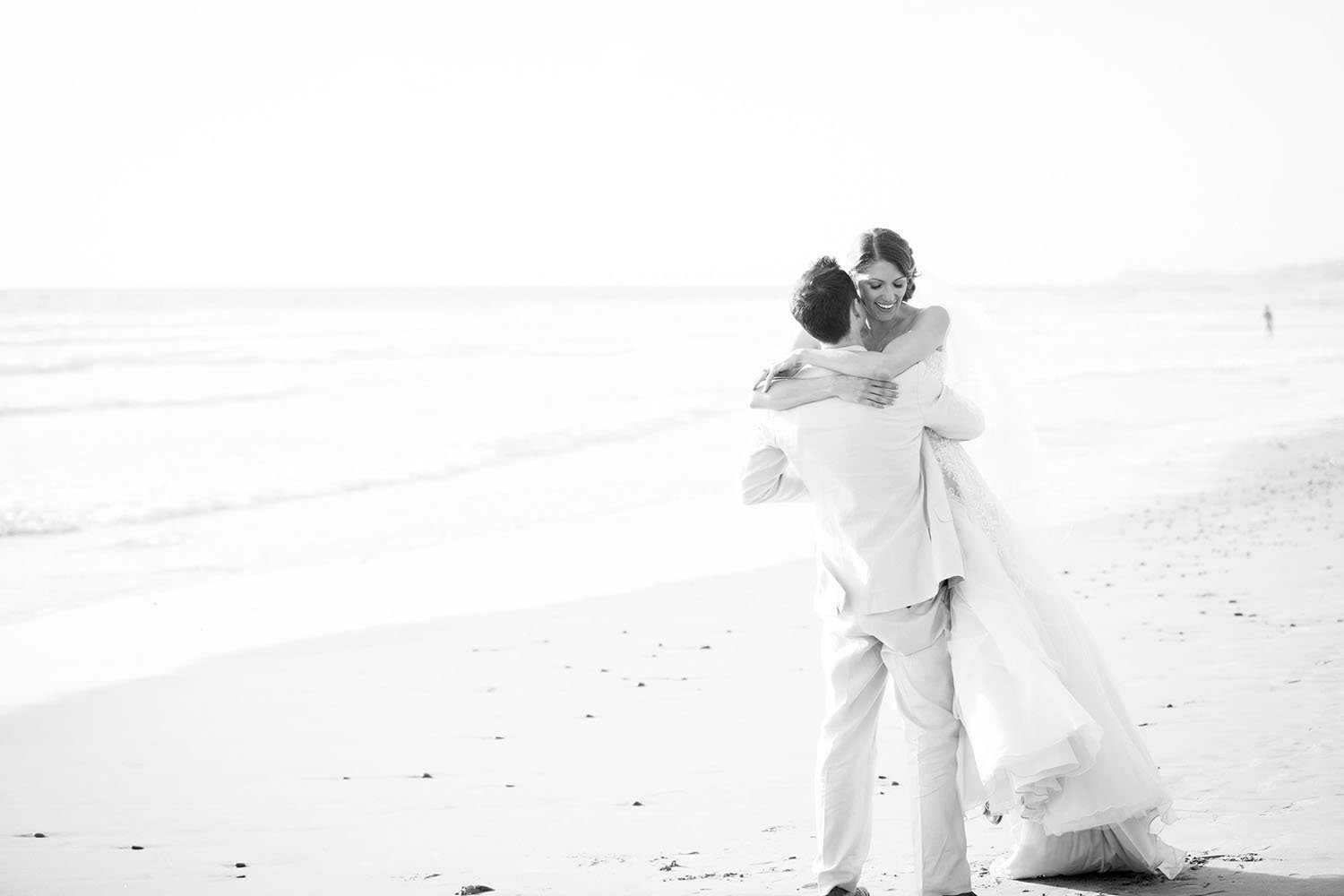 Bride and groom on the beach in Del Mar | L'Auberge Wedding Photos