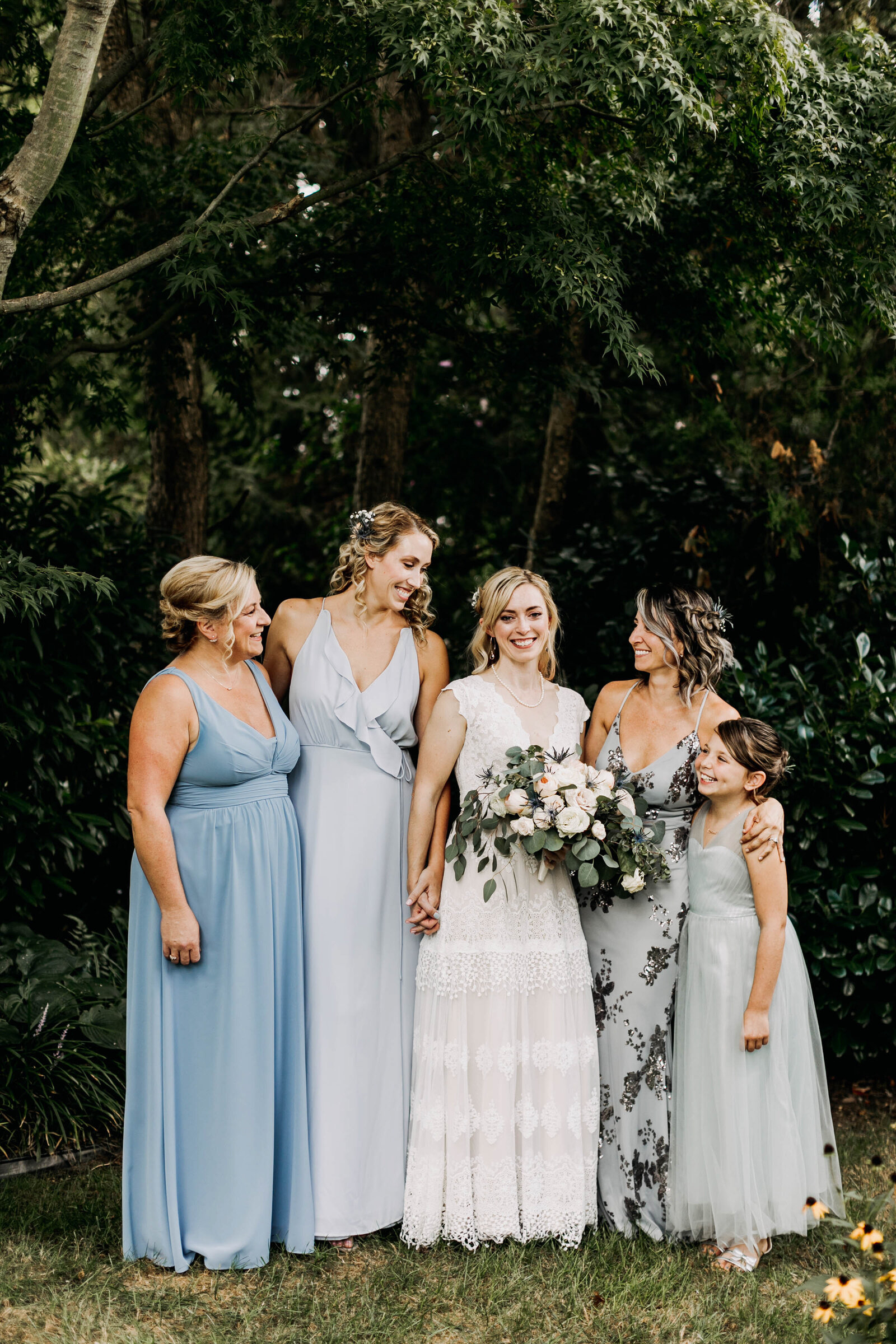 bridesmaids blue dresses in garden
