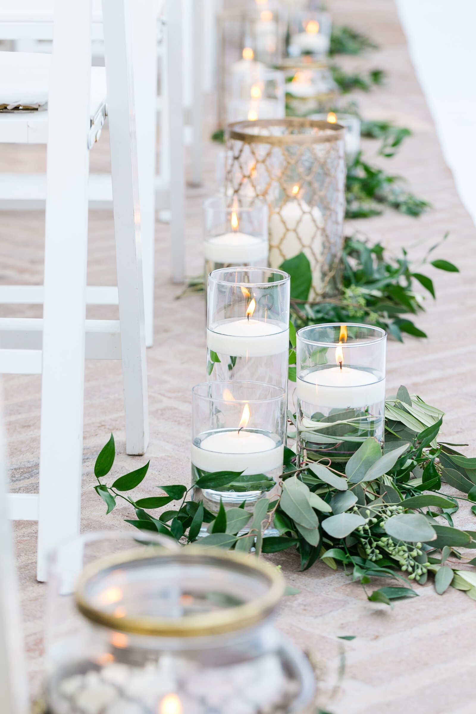 ceremony-aisle-with-candles-and-greenery