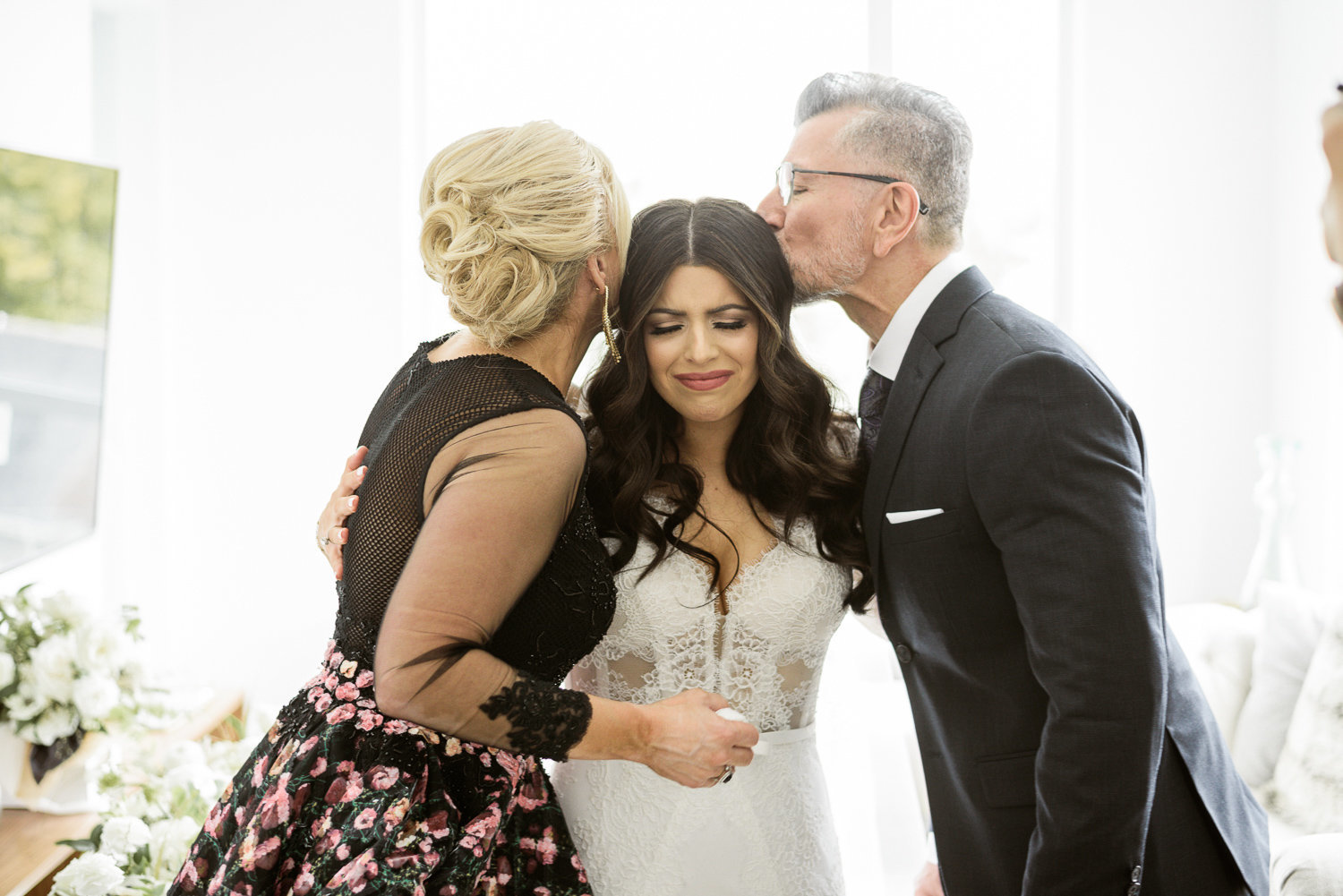 Emotional moments between bride and parents
