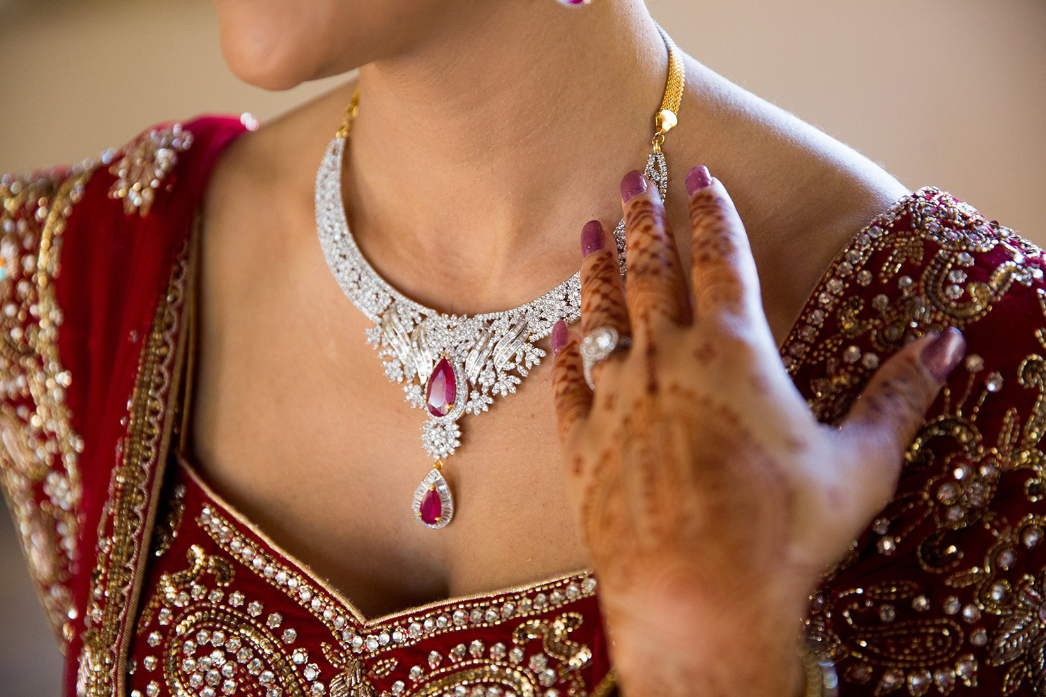 close up of jewelry and henna at a Hindu Indian cereomony