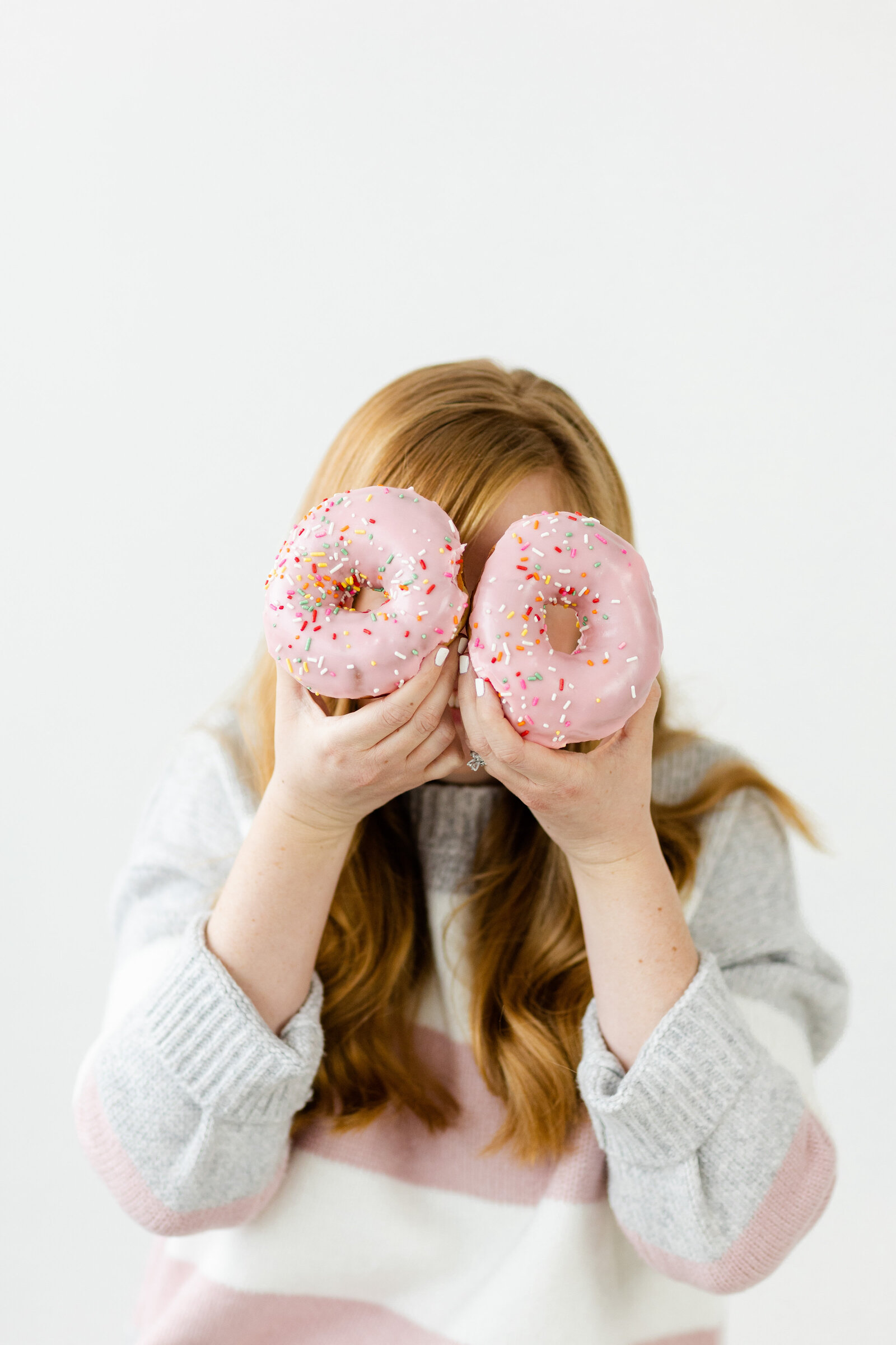 Ohio photographer posing with donuts for branding photos
