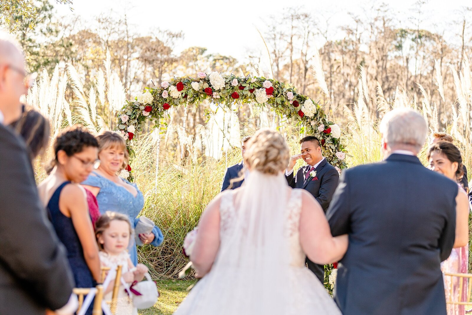 Bride walking down aisle | Four Seasons Wedding | Chynna Pacheco Photography