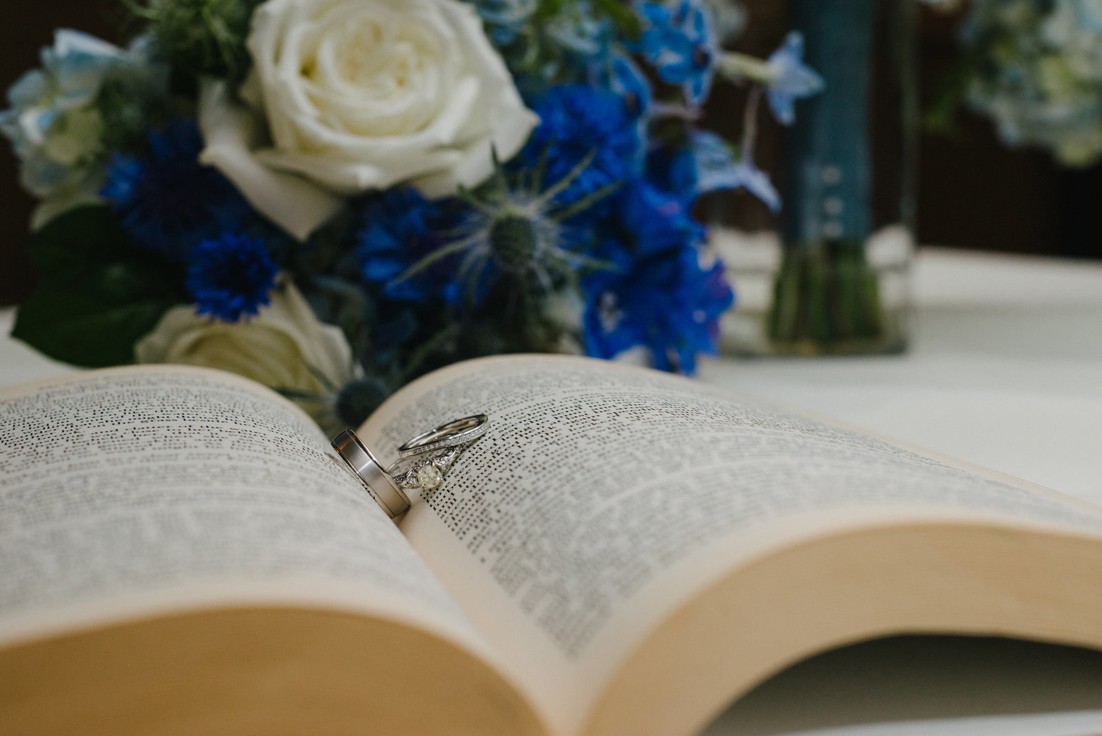 wedding rings on book