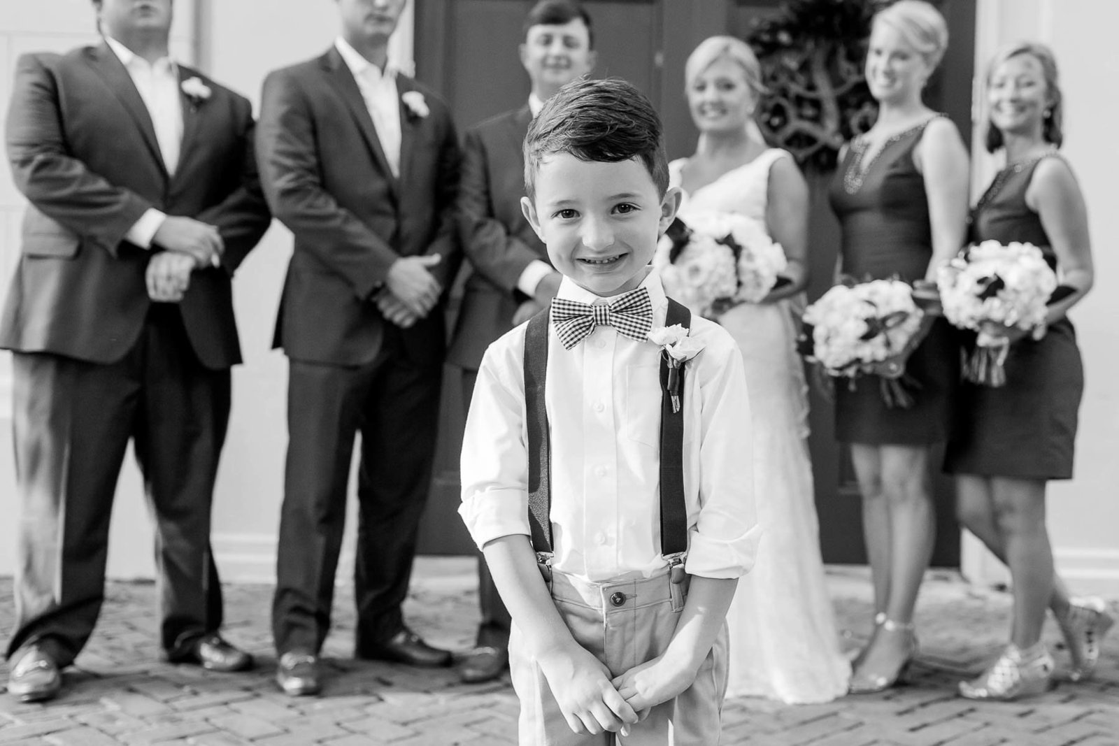 Ringbearer stands in forefront with wedding party behind him, Coleman Hall, Mt Pleasant, South Carolina