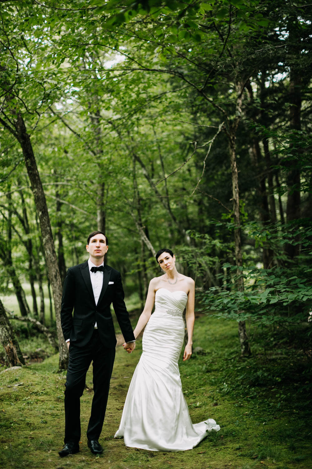 bride and groom in tux nature woods