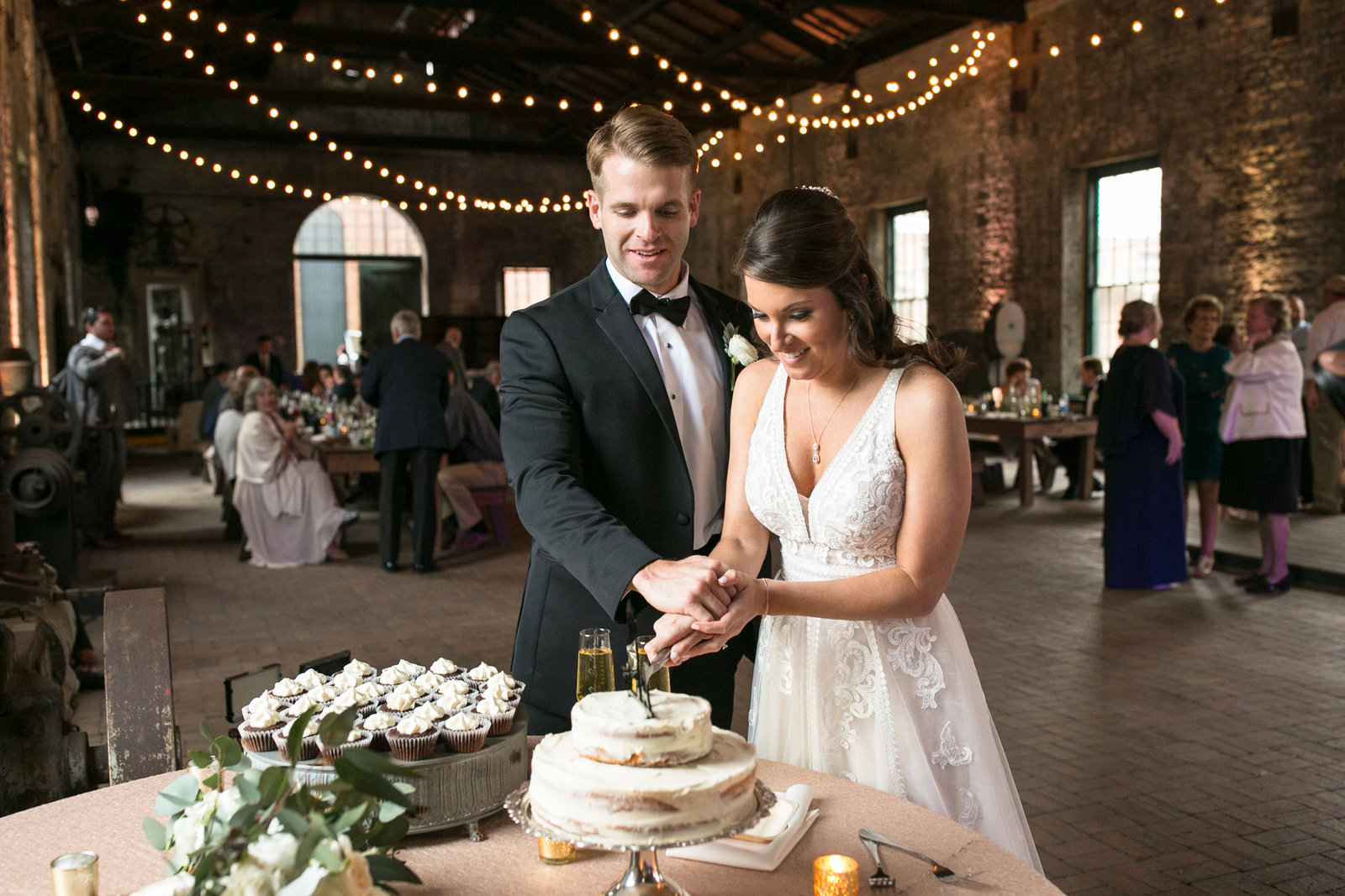 bride and groom cutting cake at roundhouse railroad museaum wedding savannah georgia