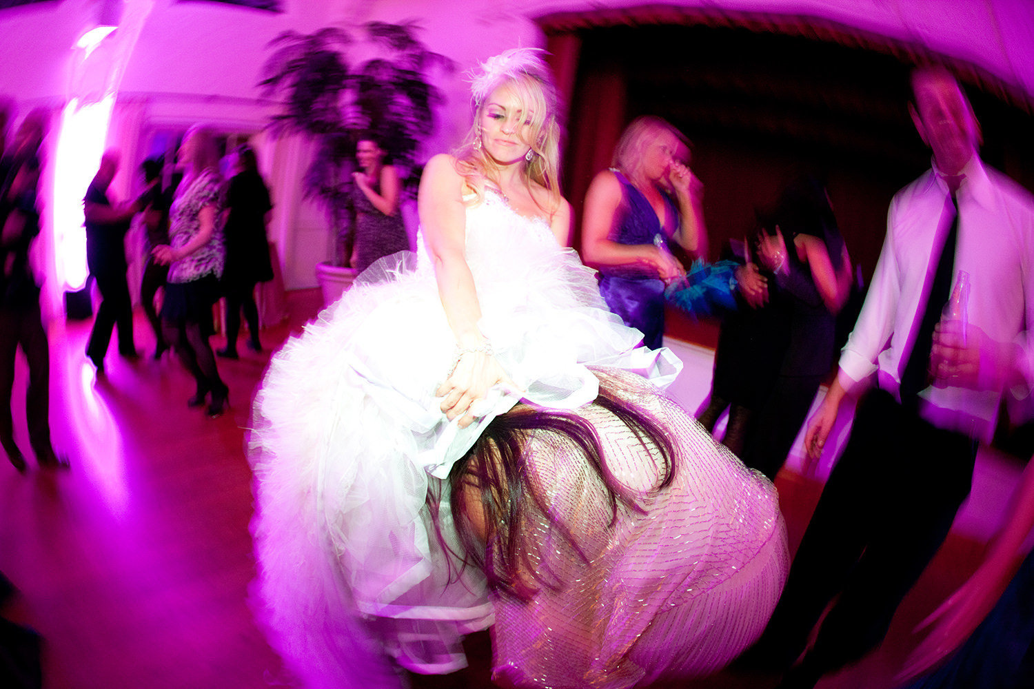 fun dancing image with bride and friends