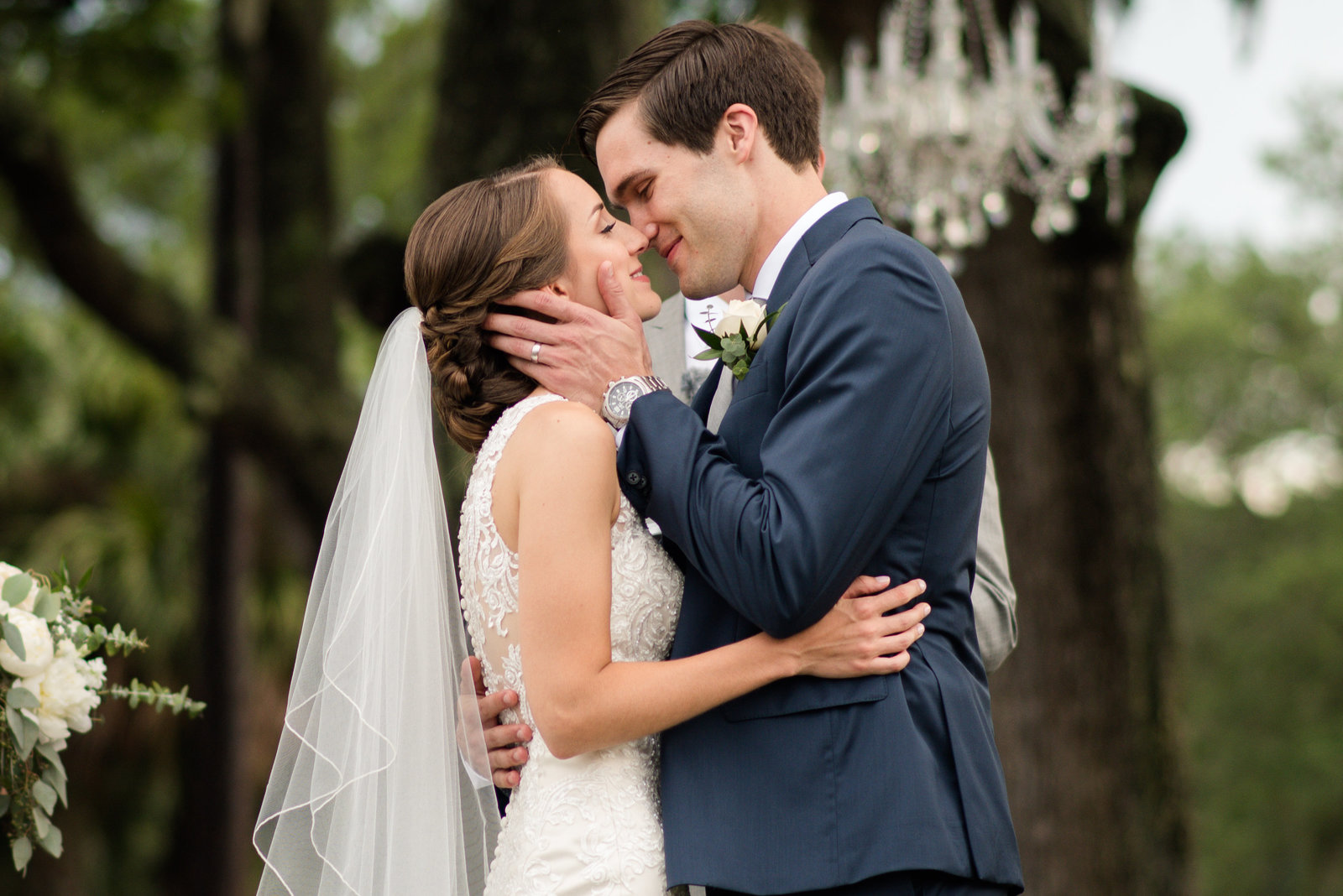 bride and groom kiss during wedding ceremony at callawassie island club wedding by south carolina wedding photographer