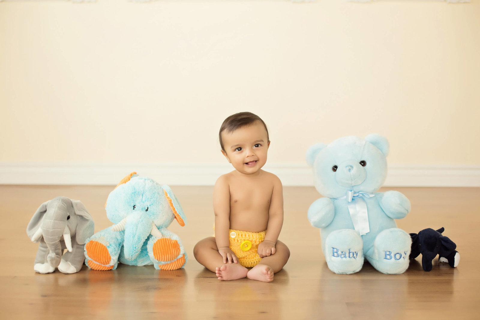 baby boy and stuffed animals photoshoot