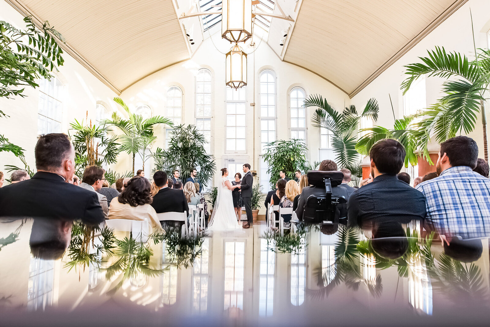 Creative reflection of Piper Palm House wedding venue during wedding ceremony in St. Louis
