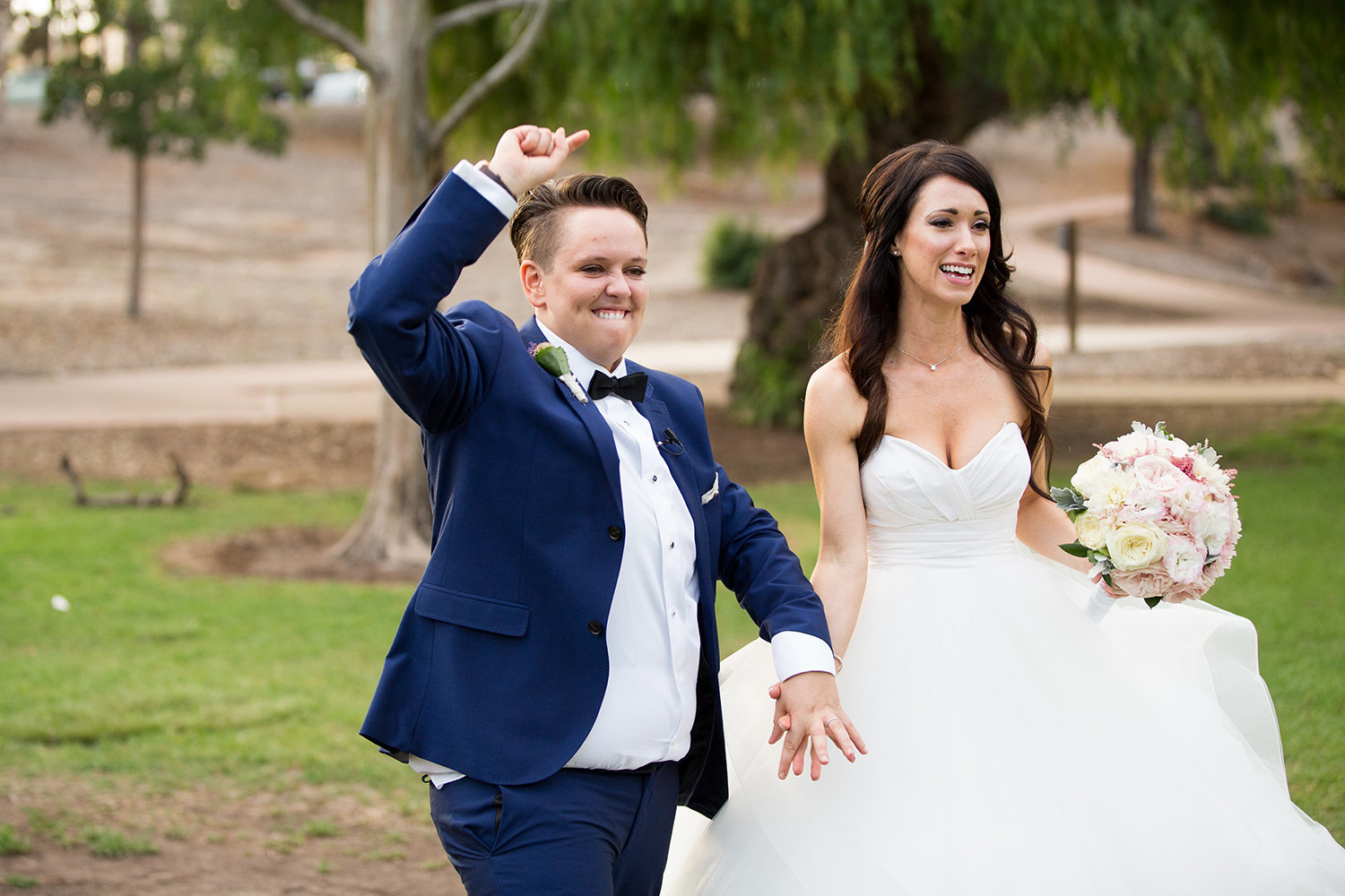 Married! Lets party.  Brides celebrate after their wedding ceremony at Balboa Park in San Diego | LGBT Wedding