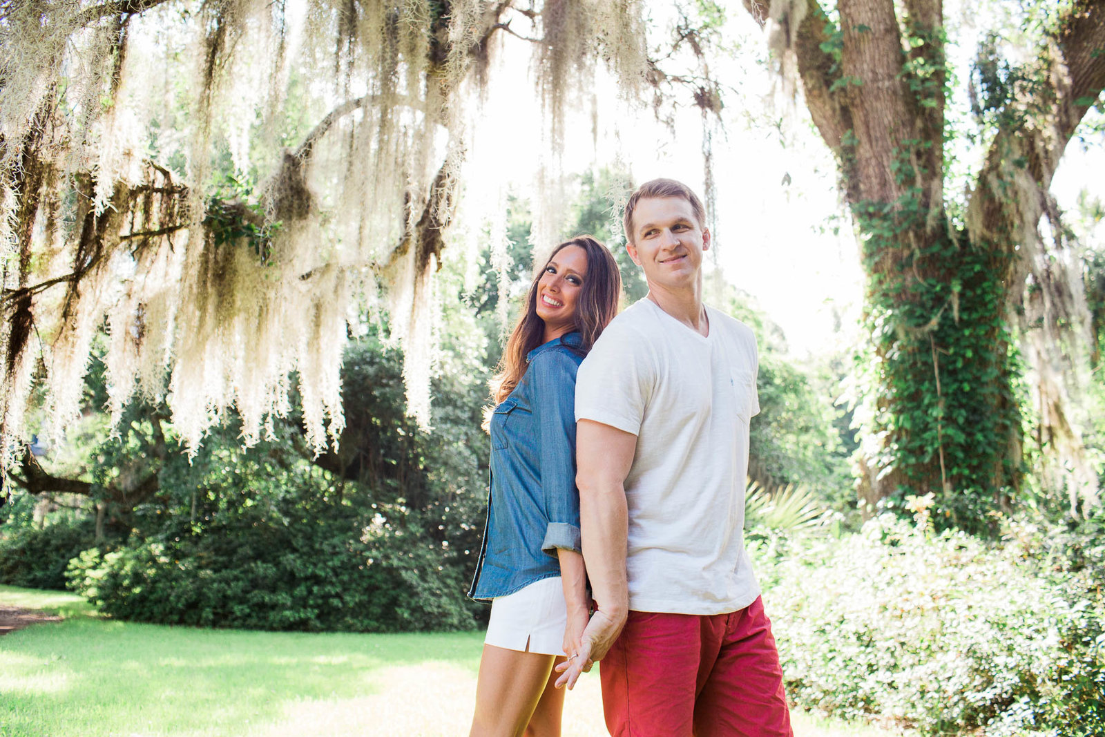 Engaged couple casually pose under spanish moss, Magnolia Plantation, Charleston, South Carolina