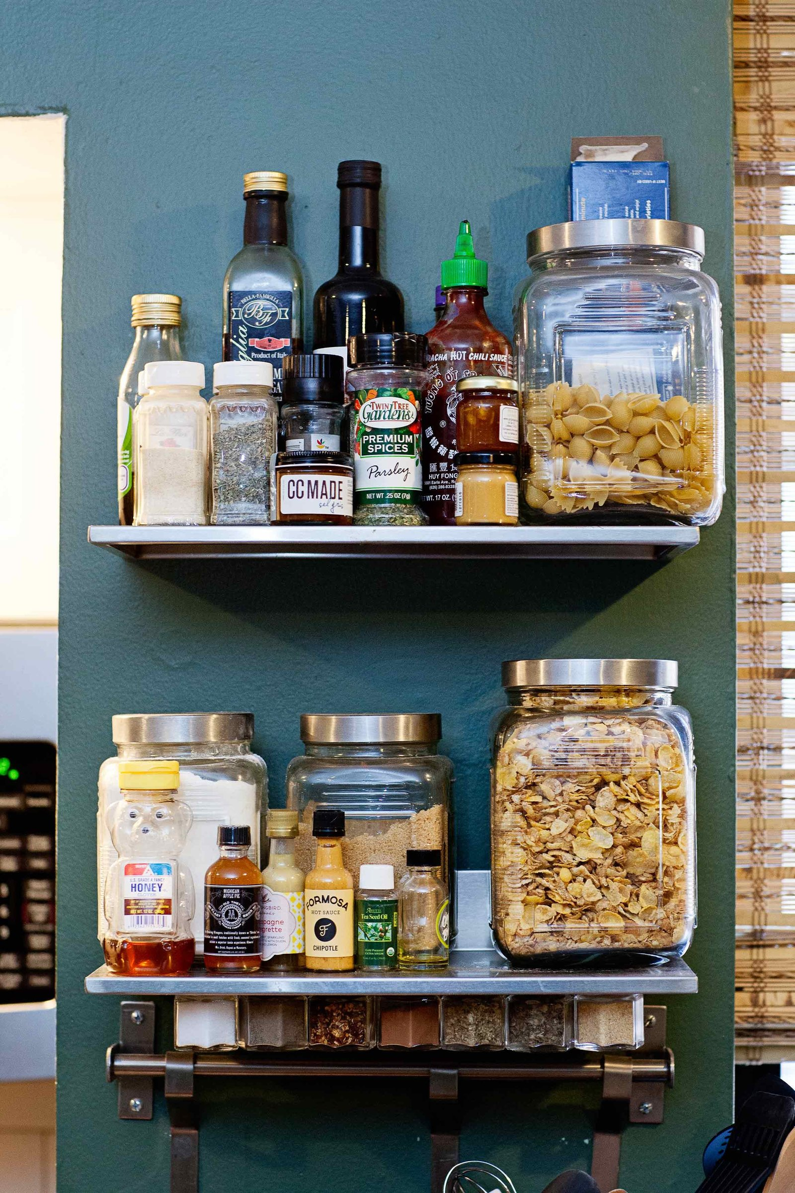 Floating shelves with spices and glass jars with foods.