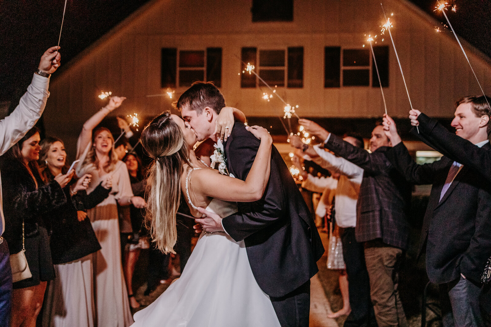 J.Michelle Photography photographs bride and groom leaving during a sparkler exit at vintage oaks farm wedding in Athens, Ga