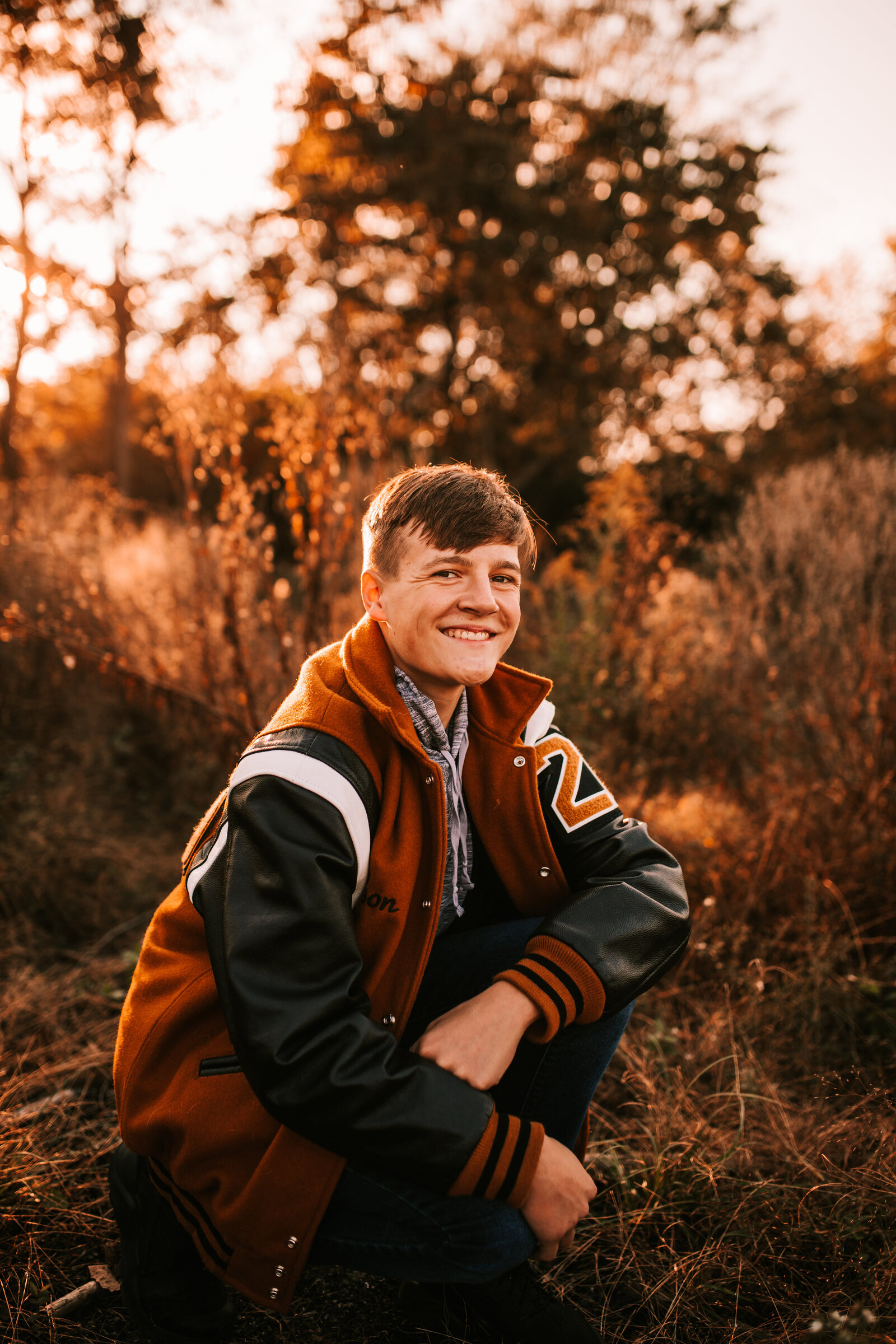 senior session boy with letter jacket